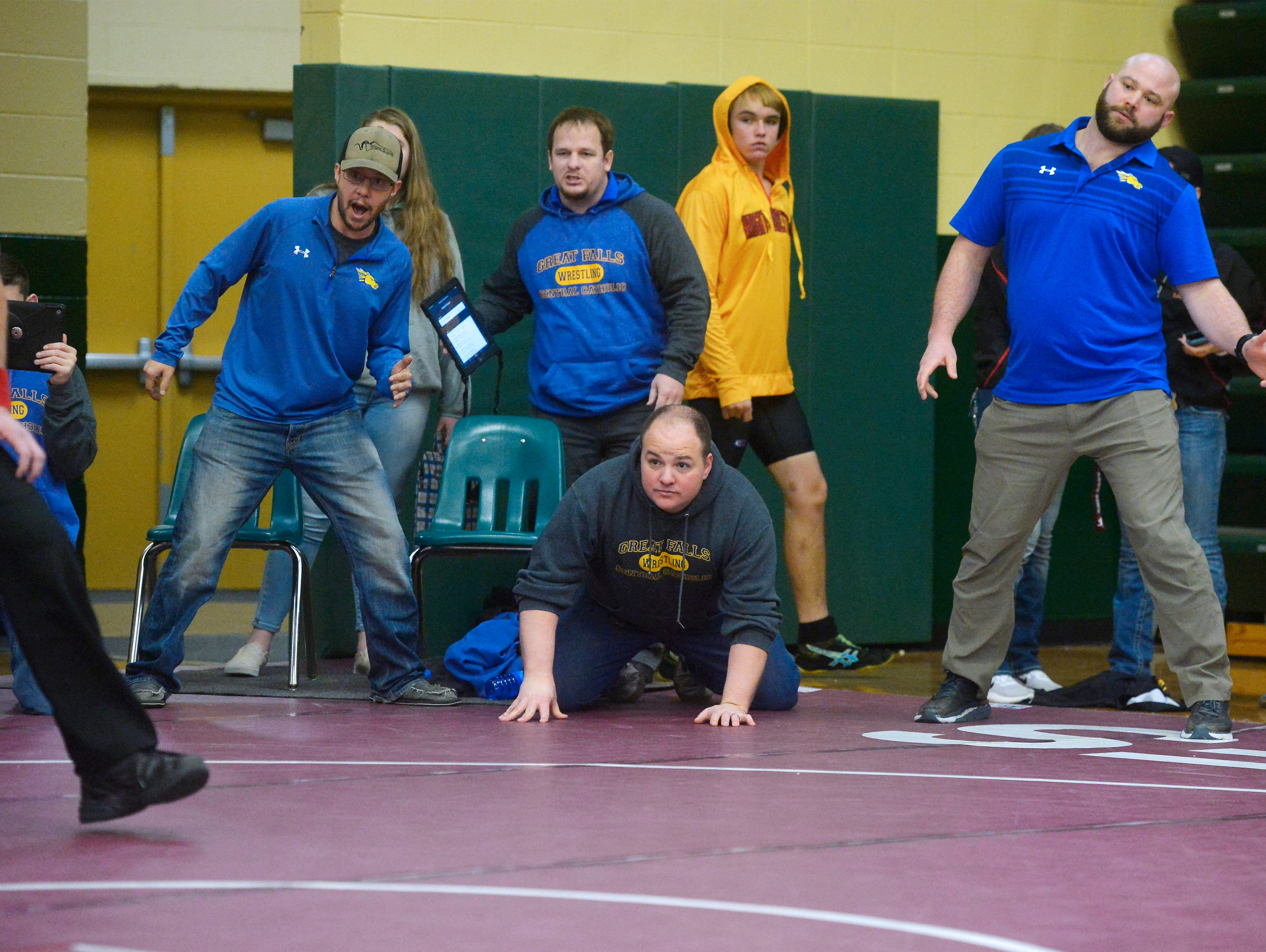 Great Falls Central coaches watch their wrestler during the CMR Holiday Classic Wrestling Tournament in the CMR Fieldhouse on Friday.