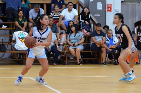 Team co-captain Nicole Pineda scans the floor during the St. Paul Christian Warriors junior varsity basketball game against the Simon Sanchez Sharks in early November. The Warriors girls team finished the season unbeaten at 15-0 to claim the 2018 title.