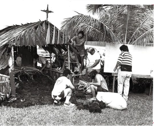 """Lumot, or moss, is used to build a bilen, or Nativity scene, at the US Marines barracks in Santa Rita. This photo is dated Dec. 6, 1989. From the original caption: """"Santa Rita villagers build a nativity scene at the lawn of the U.S. Marines barracks. From left, Ed Santos, Buck Quintanilla, Larry Naples, Jesse Dydasco and Bobuy Morita. Dydasco provided the materials for this project."""""""