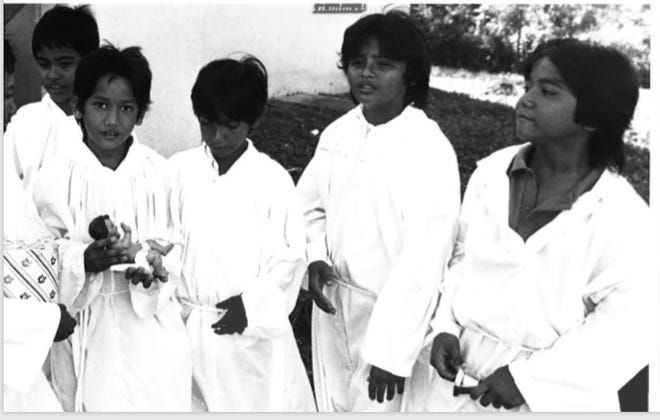 Altar boys Jay Iriarte, Kenneth Ogo, Gilbert Blas, Benny Ogo, Mark Alvarez and Norbet Iriarte from the Sta. Teresita Church are seen carrying a statue of the Niñu Jesus in this photo dated Jan. 4, 1988.