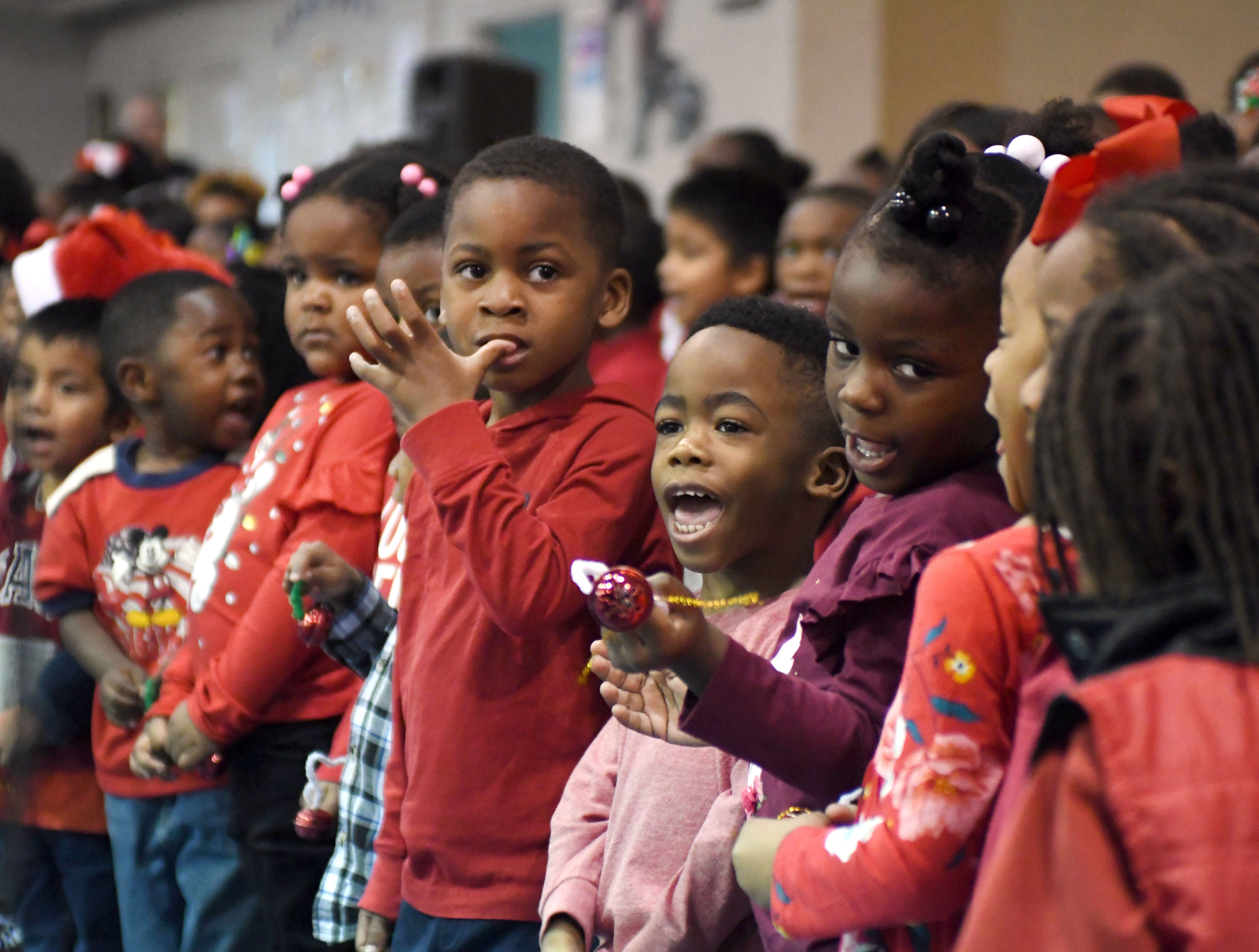 Gallery | Earl Travillion surprises students with donated bicycles for the holidays