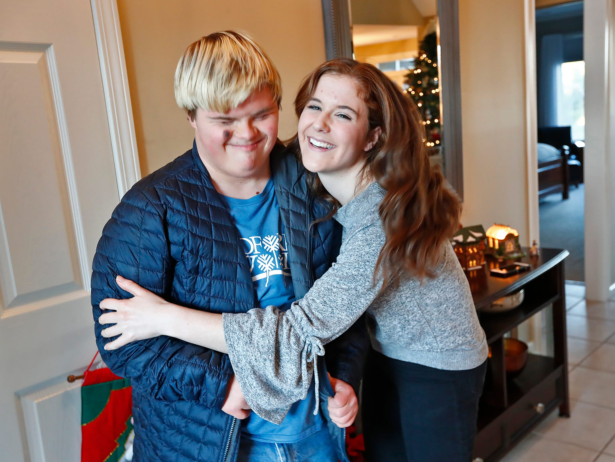 Molly Shaffer, right, says goodbye to Sky Simpson after hanging out at Molly's home, Wednesday, Dec. 12, 2018. The two have been best friends since fourth grade.