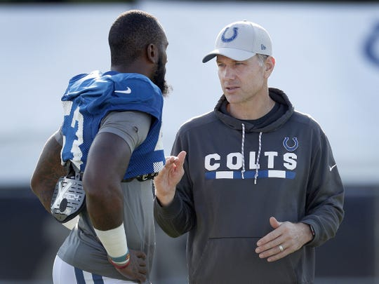 Indianapolis Colts defensive coordinator Matt Eberflus talks with linebacker Darius Leonard (53) during the Colts training camp at Grand Park in Westfield on Monday, August 6, 2018.