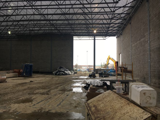 Crews work to enclose the new multipurpose gym at Westfield Middle School on Dec. 4, 2018.