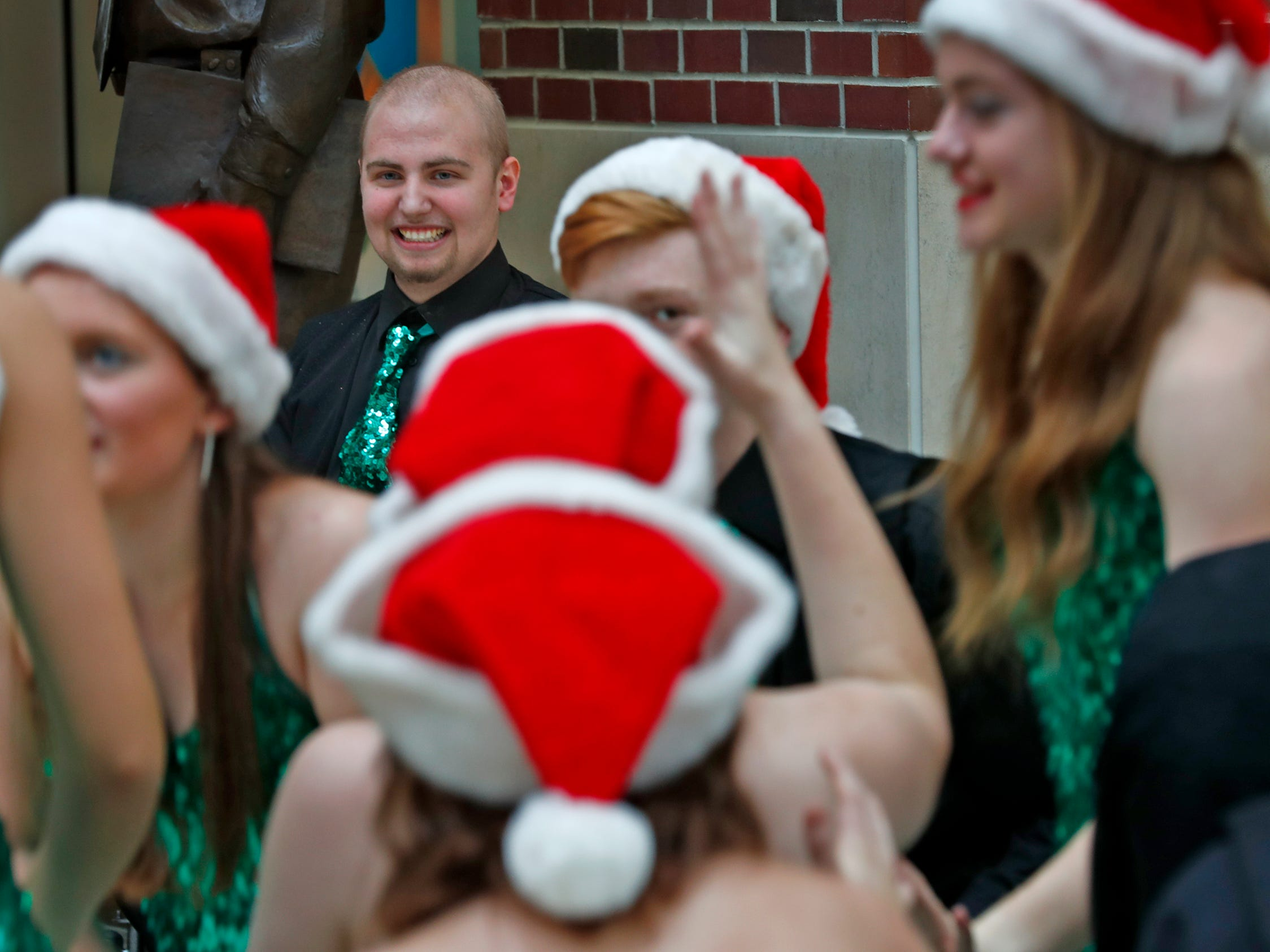 Eastern High School's Austin Hewitt, who lost his leg as a result of bone cancer, performs with his show choir at Riley Hospital, Friday, Dec. 14, 2018.