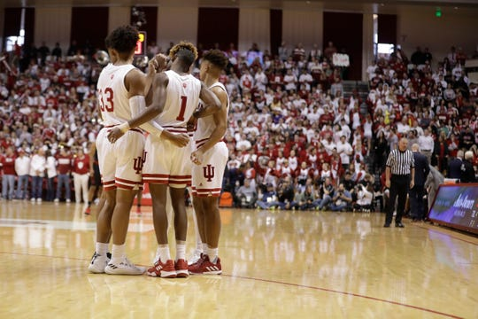 Members of the Indiana team huddle before an NCAA college basketball game against Louisville, Saturday, Dec. 8, 2018, in Bloomington, Ind.