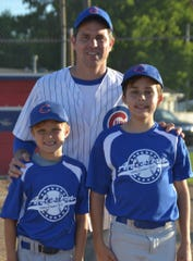 Rodric Bray and his sons, Ethan (left) and Austin.