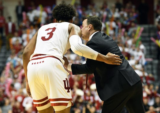 Indiana Hoosiers forward Justin Smith (3) talks to Indiana Hoosiers head coach Archie Miller during the game against Louisville at Simon Skjodt Assembly Hall in Bloomington, Ind., on Saturday, Dec. 8, 2018.