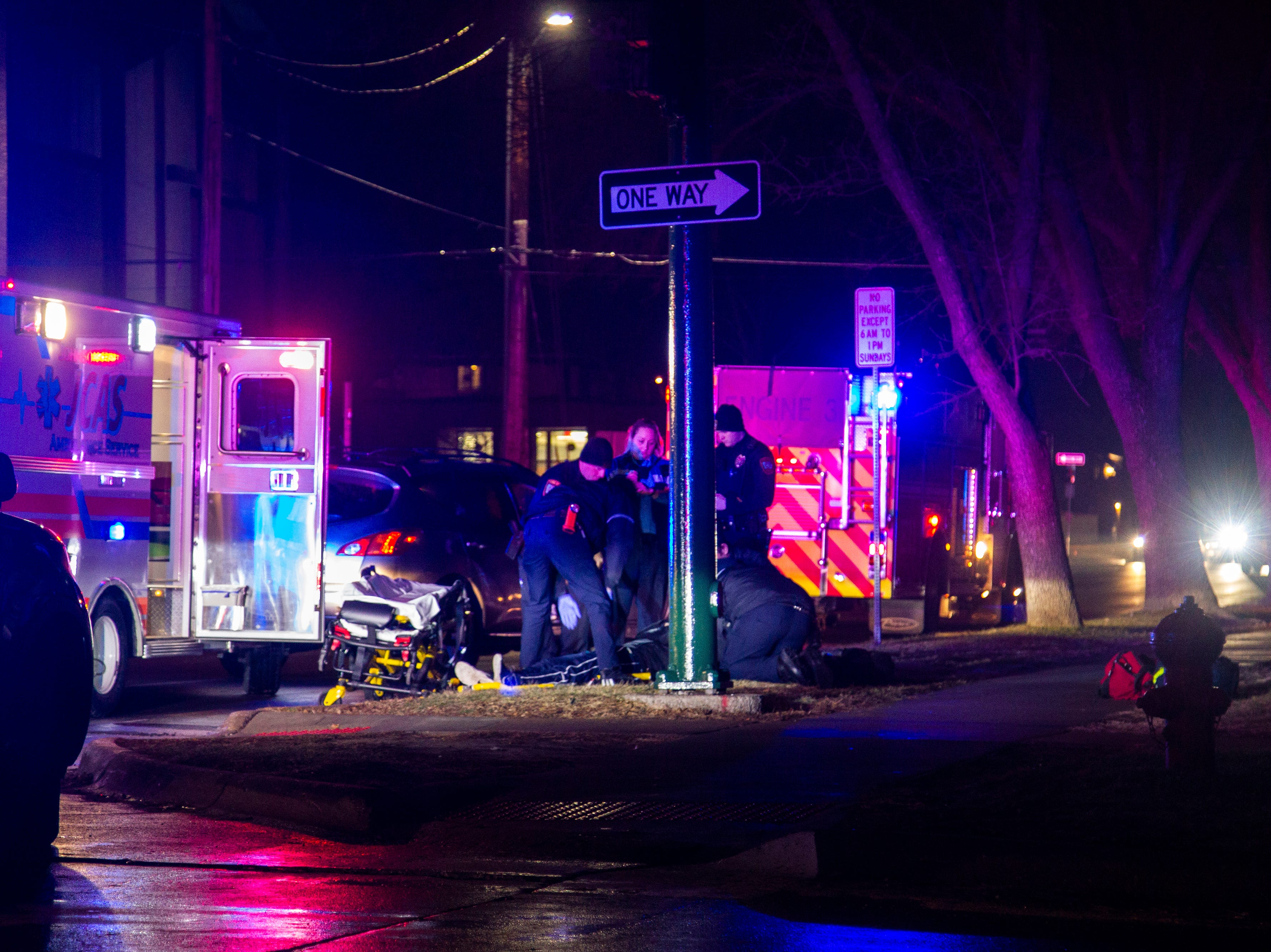 Iowa City police, firefighters and Johnson County paramedics respond to a collision involving an SUV and a pedestrian on Thursday, Dec. 13, 2018, along Dubuque Street between Jefferson and Market Streets in Iowa City.