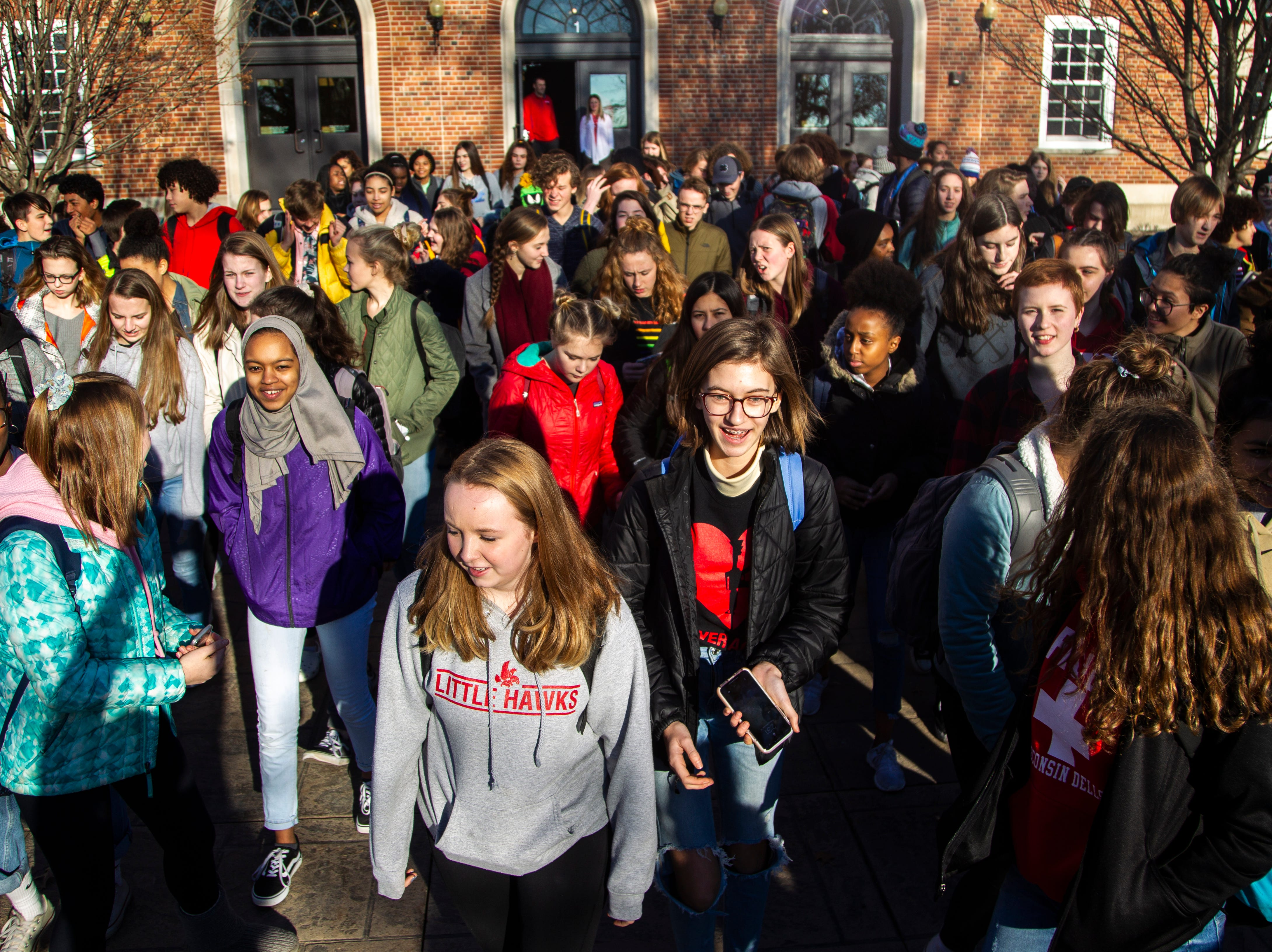 City High students march towards downtown during a walkout on Friday, Dec. 14, 2018, in Iowa City. The Students Against School Shootings group organized the walkout to land on the 6th anniversary of the Sandy Hook school shooting.