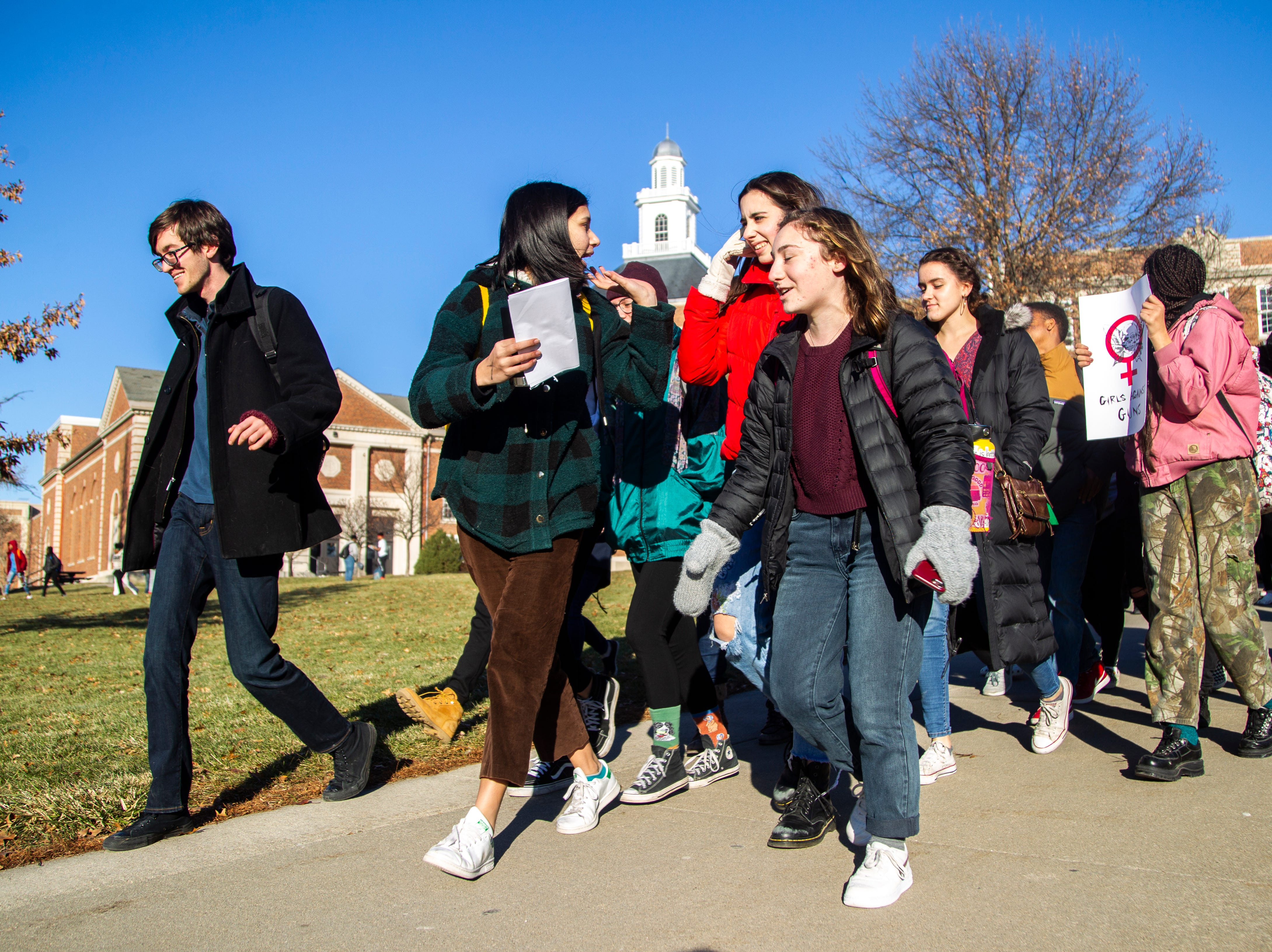 City High sophomore Shoshie Hemley (center) leads City High students while they march towards downtown during a walkout on Friday, Dec. 14, 2018, in Iowa City. The Students Against School Shootings group organized the walkout to land on the 6th anniversary of the Sandy Hook school shooting.