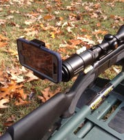 Smartphone adapters such as this one made by SnakeLook are helping hunters with visual and physical challenges.