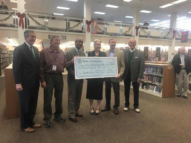 Tennessee Secretary of State Tre Hargett (far left) presents a check for $1,200 to the Jackson-Madison County Library. Also in the picture are Library Tennessee Room Coordinator Jack Wood, State Representative Johnny Shaw, Library Executive Director Dinah Harris, State Representative Chris Todd and Jackson Mayor Jerry Gist.