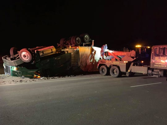 A truck loaded with potato chips and food products overturned Thursday evening on Highway 64.