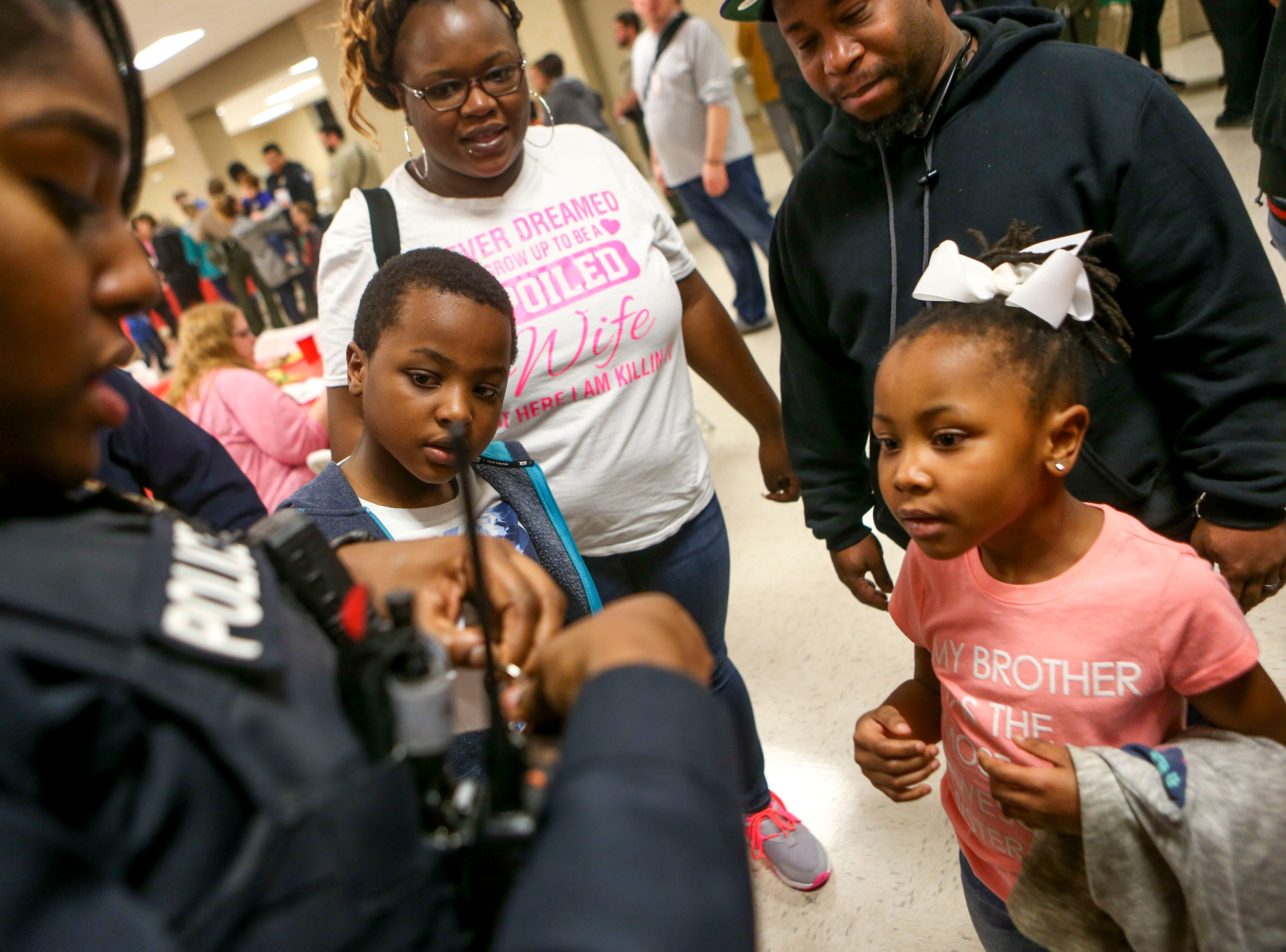 Milan Police Sgt. Chasity Strayhorn presents Catori Dunlap, 6, right, and Steve Hunter, 7, left, a special set of keys during the matching time for Shop with a Cop at Hawkins-Whitby Fema Community Safe Room in Milan, Tenn., on Thursday, Dec. 13, 2018.