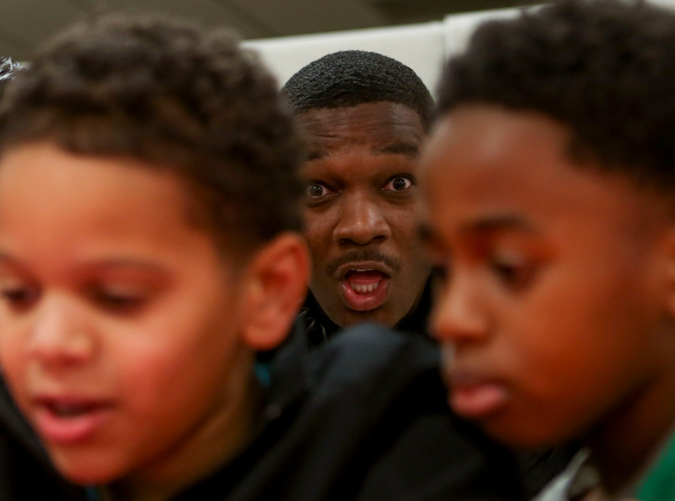 Dominique Moore, a patrol officer with Milan, photo bombs between Jayden Williams, 9, and Jeremiah Conley, 8, during the matching time for Shop with a Cop at Hawkins-Whitby Fema Community Safe Room in Milan, Tenn., on Thursday, Dec. 13, 2018.