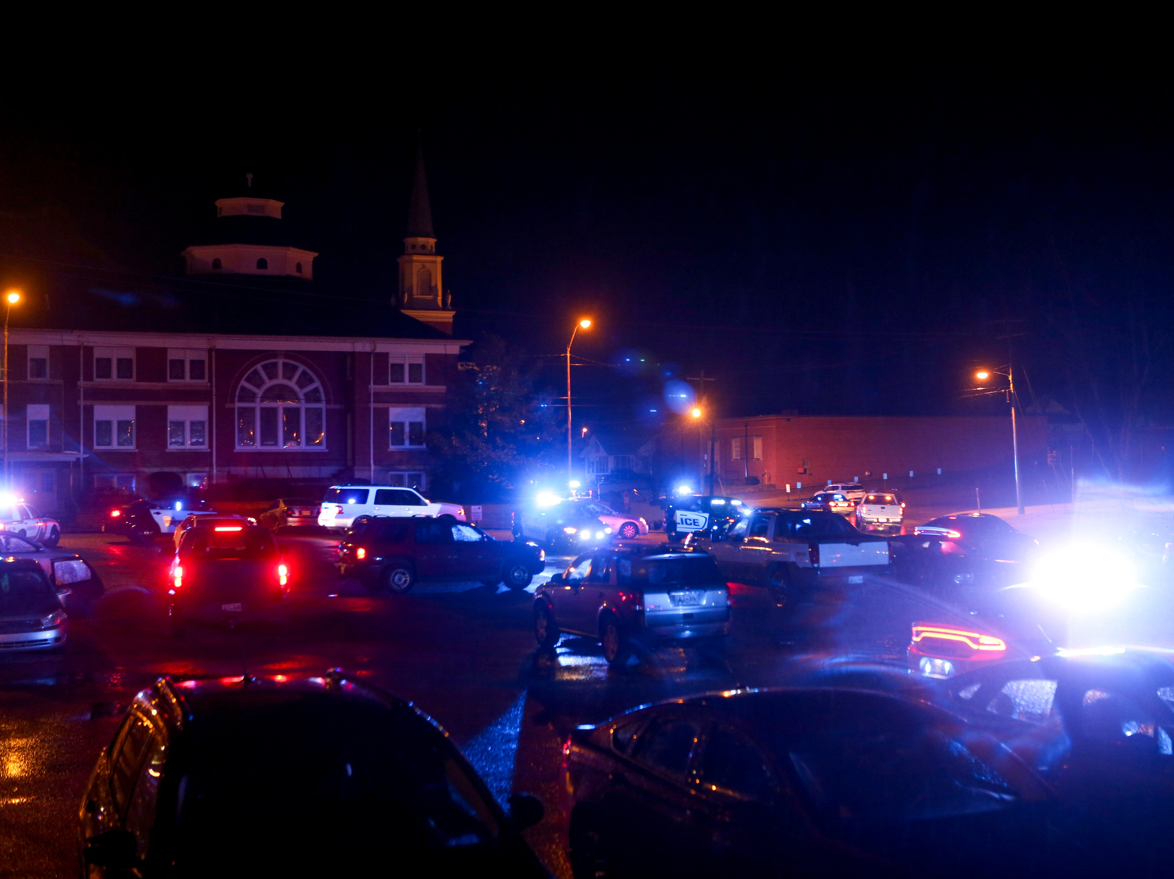 Law enforcement officers all turn on their lights and sirens during the parade leading towards Walmart during the matching time for Shop with a Cop at Hawkins-Whitby Fema Community Safe Room in Milan, Tenn., on Thursday, Dec. 13, 2018.
