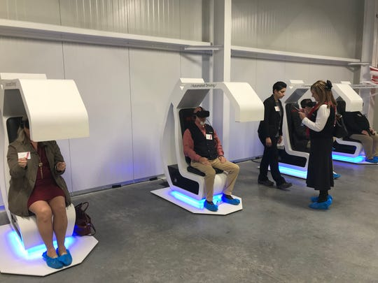 Guests at the opening of DENSO's newest Maryville plant try out virtual reality driving Dec. 14, 2018.