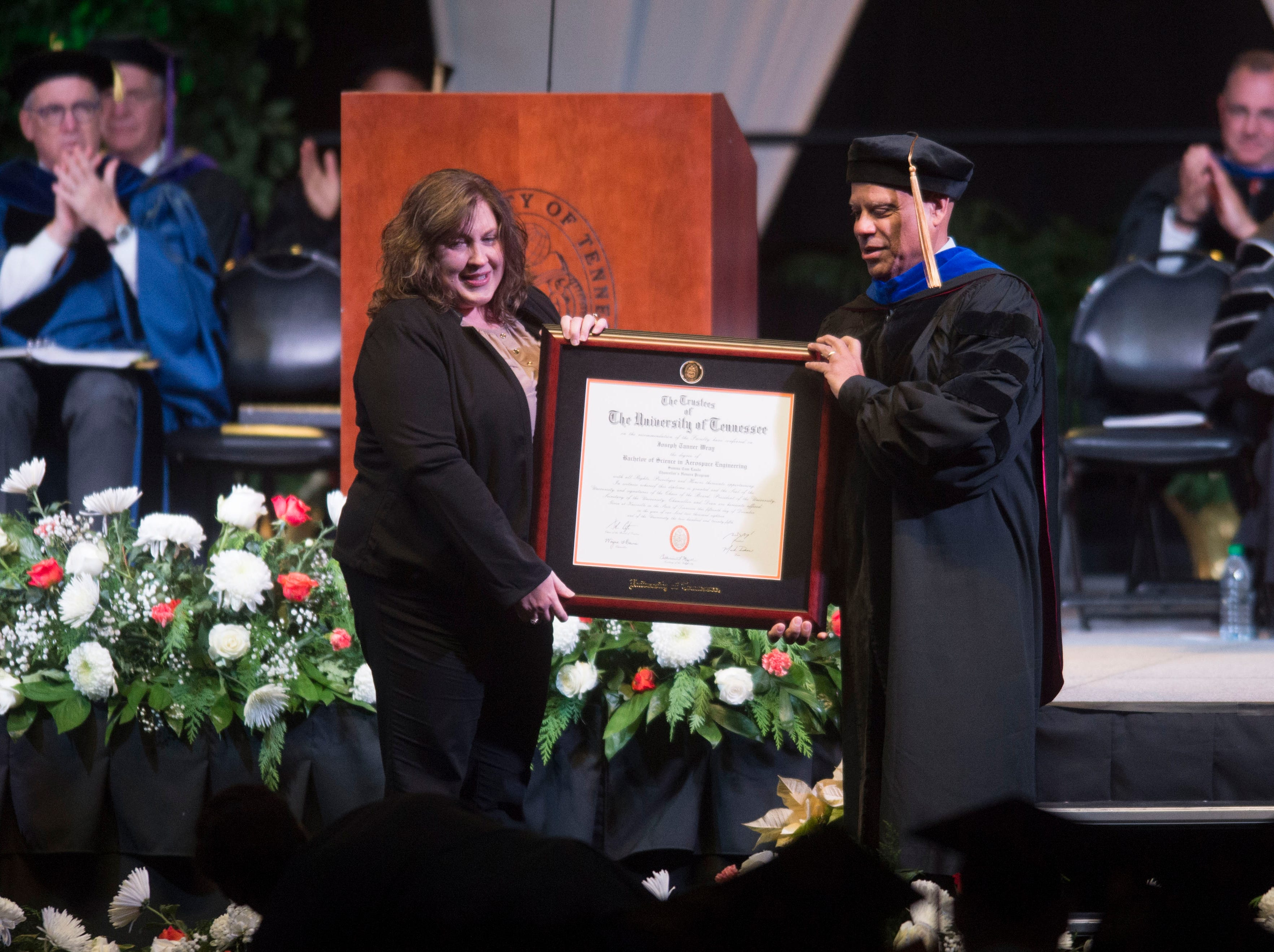 "Amy Schiller receives a posthumous degree for her son Joseph ""Tanner"" Wray in Thompson-Boling at University of Tennessee's graduation Friday, Dec. 14, 2018. Wray died in February during a charity boxing match."