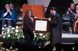 """Amy Schiller receives a posthumous degree for her son Joseph """"Tanner"""" Wray in Thompson-Boling at University of Tennessee's graduation Friday, Dec. 14, 2018. Wray died in February during a charity boxing match."""