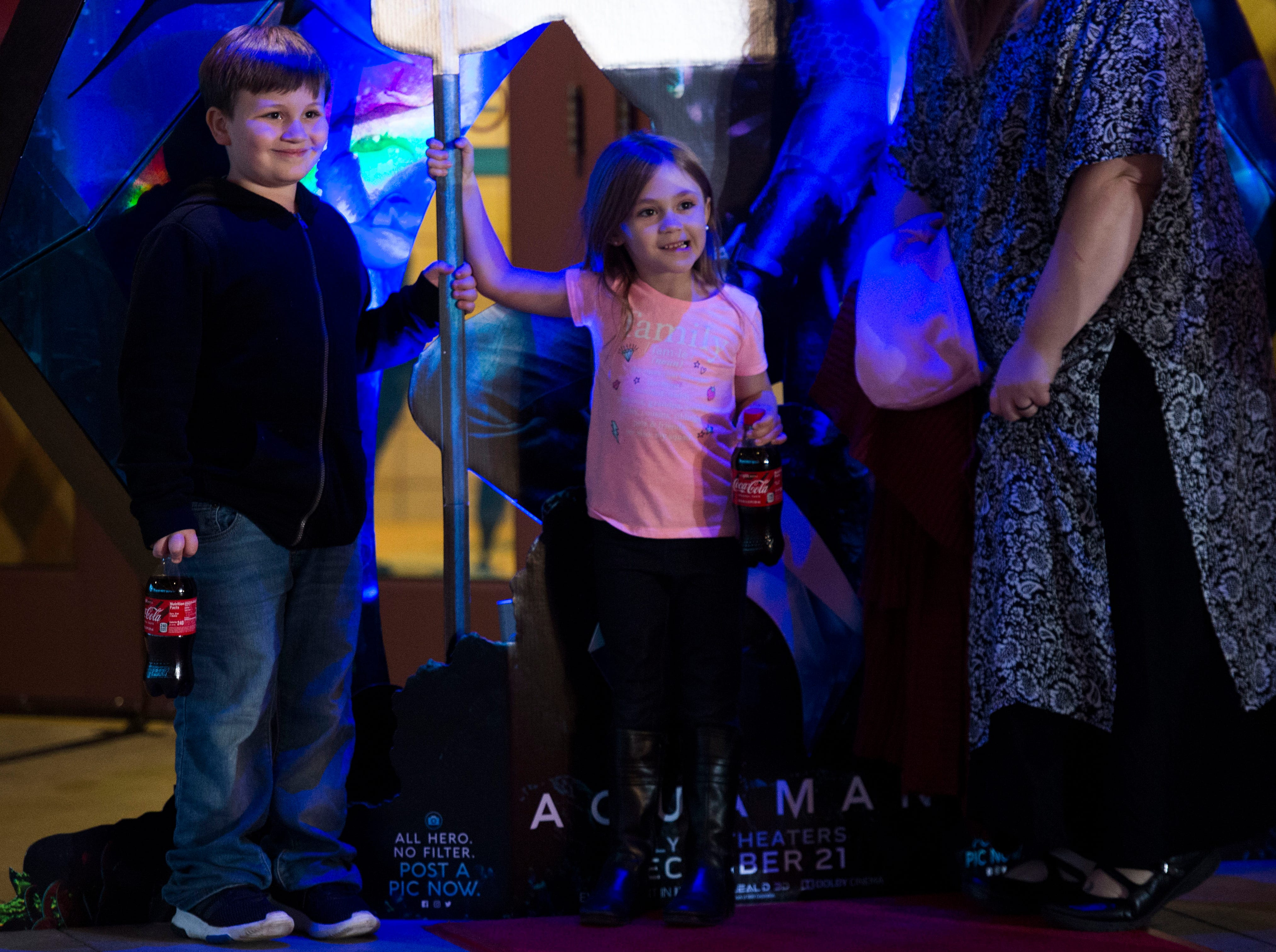 """Children pose for a photo while waiting in line for Regal's annual red carpet premiere for Variety of """"Aquaman"""" at Regal Pinnacle Stadium 18, Thursday, Dec. 13, 2018. """"Aquaman"""" star Patrick Wilson walked the red carpet before the screening."""