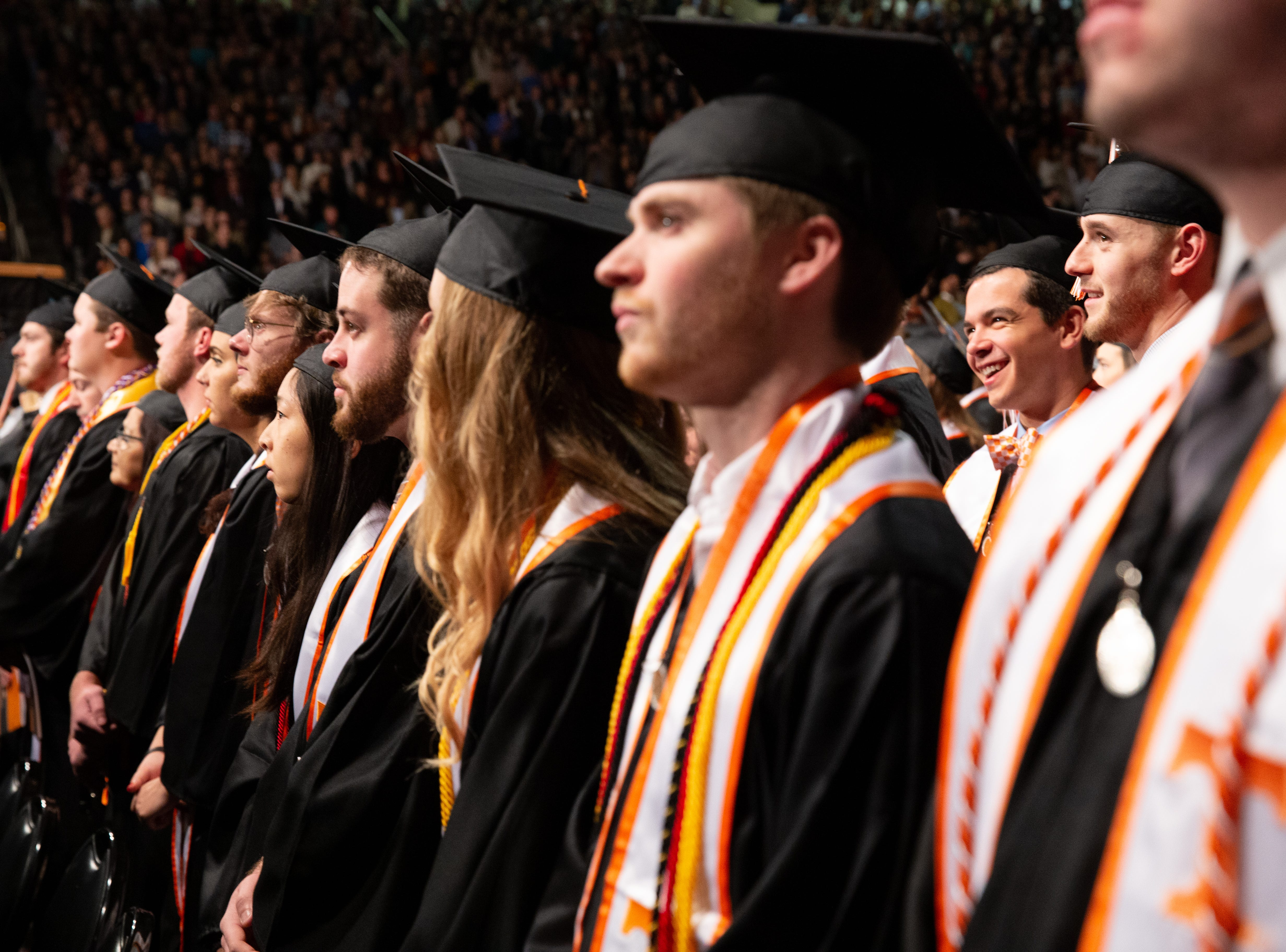 Graduates mingle before the ceremony begins during the University of Tennessee winter Commencement ceremony at Thompson-Boling Assembly Center and Arena in Knoxville Friday, Dec. 14, 2018.