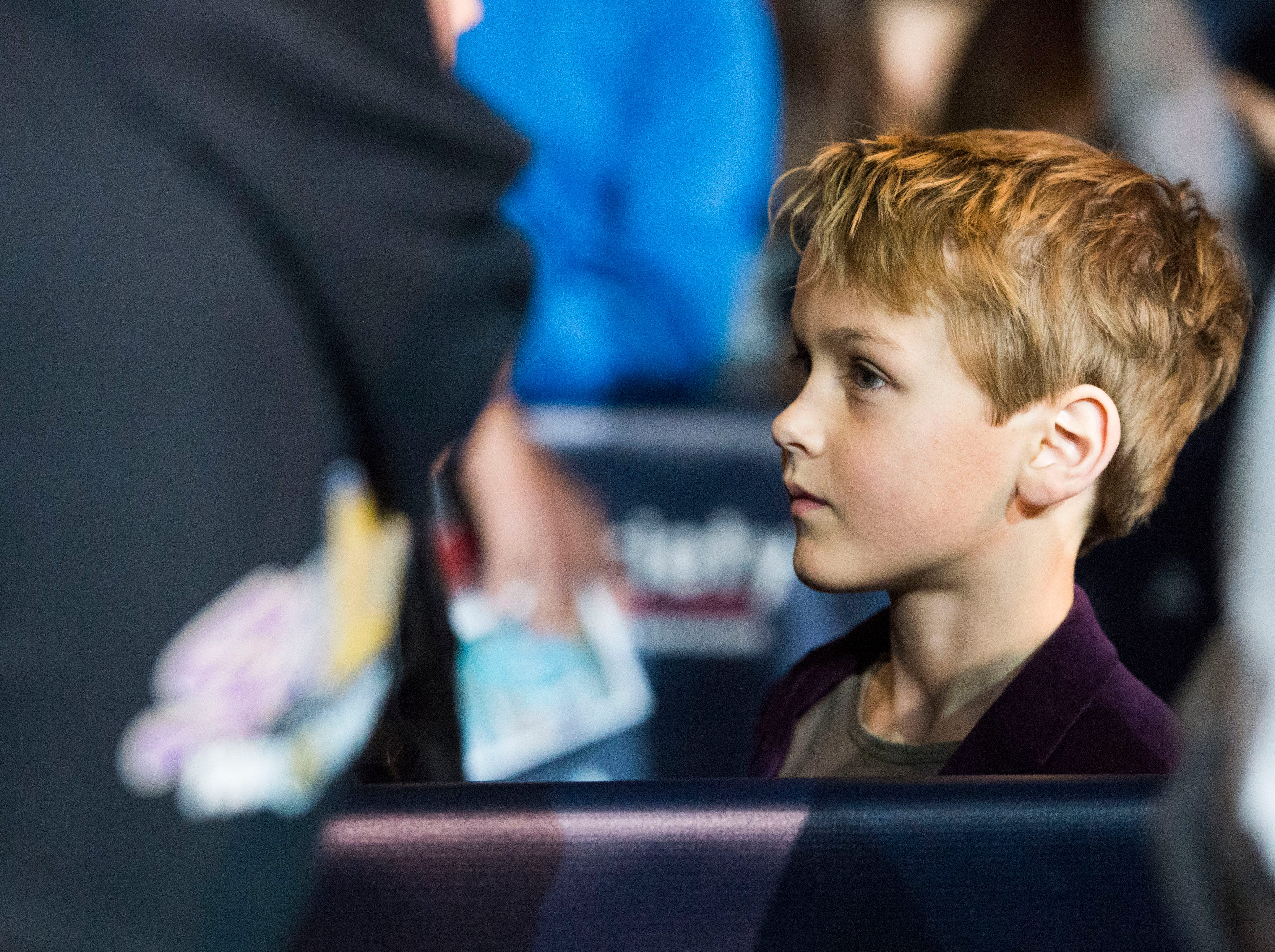 Kasian Wilson, Patrick Wilson's son, watches his father greet fans at Regal's annual red carpet premiere for Variety at Regal Pinnacle Stadium 18, Thursday, Dec. 13, 2018.