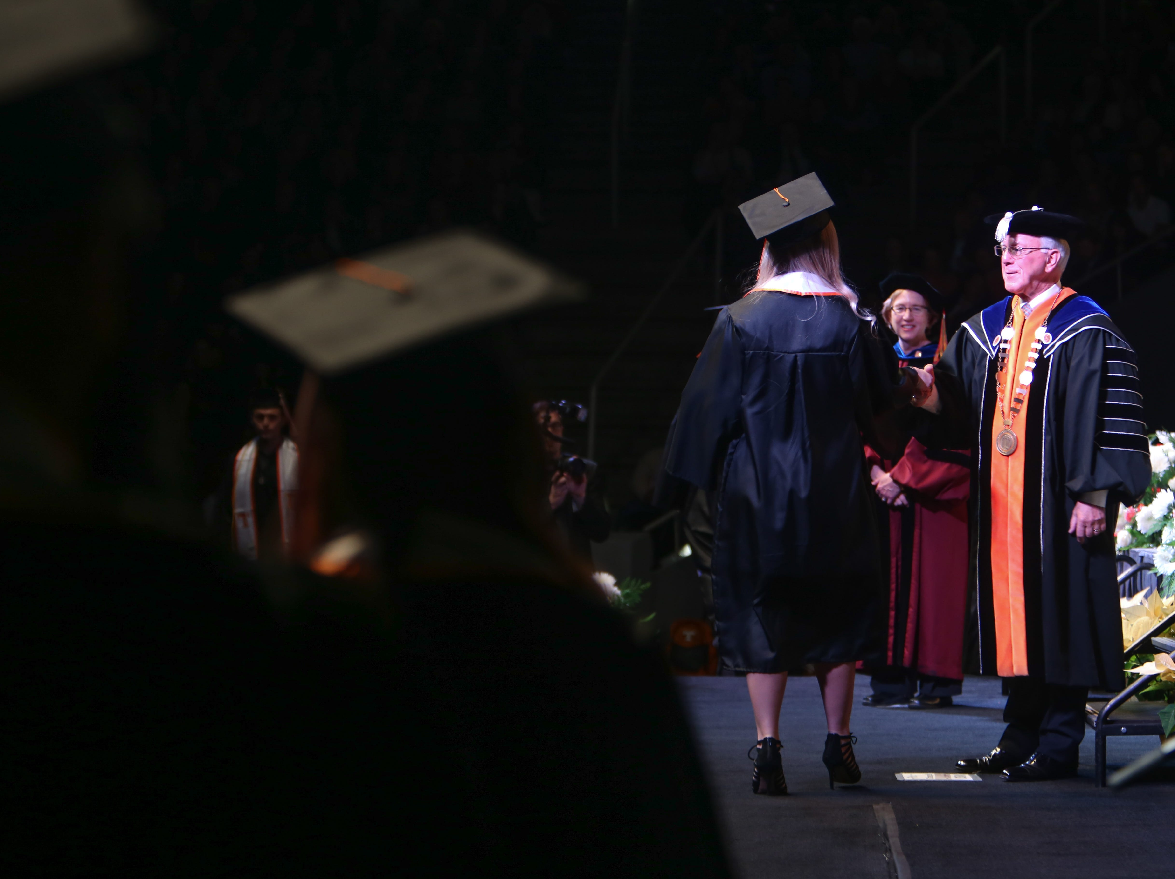 Chancellor Wayne T. Davis shakes hands with the graduates during the University of Tennessee winter Commencement ceremony at Thompson-Boling Assembly Center and Arena in Knoxville Friday, Dec. 14, 2018.