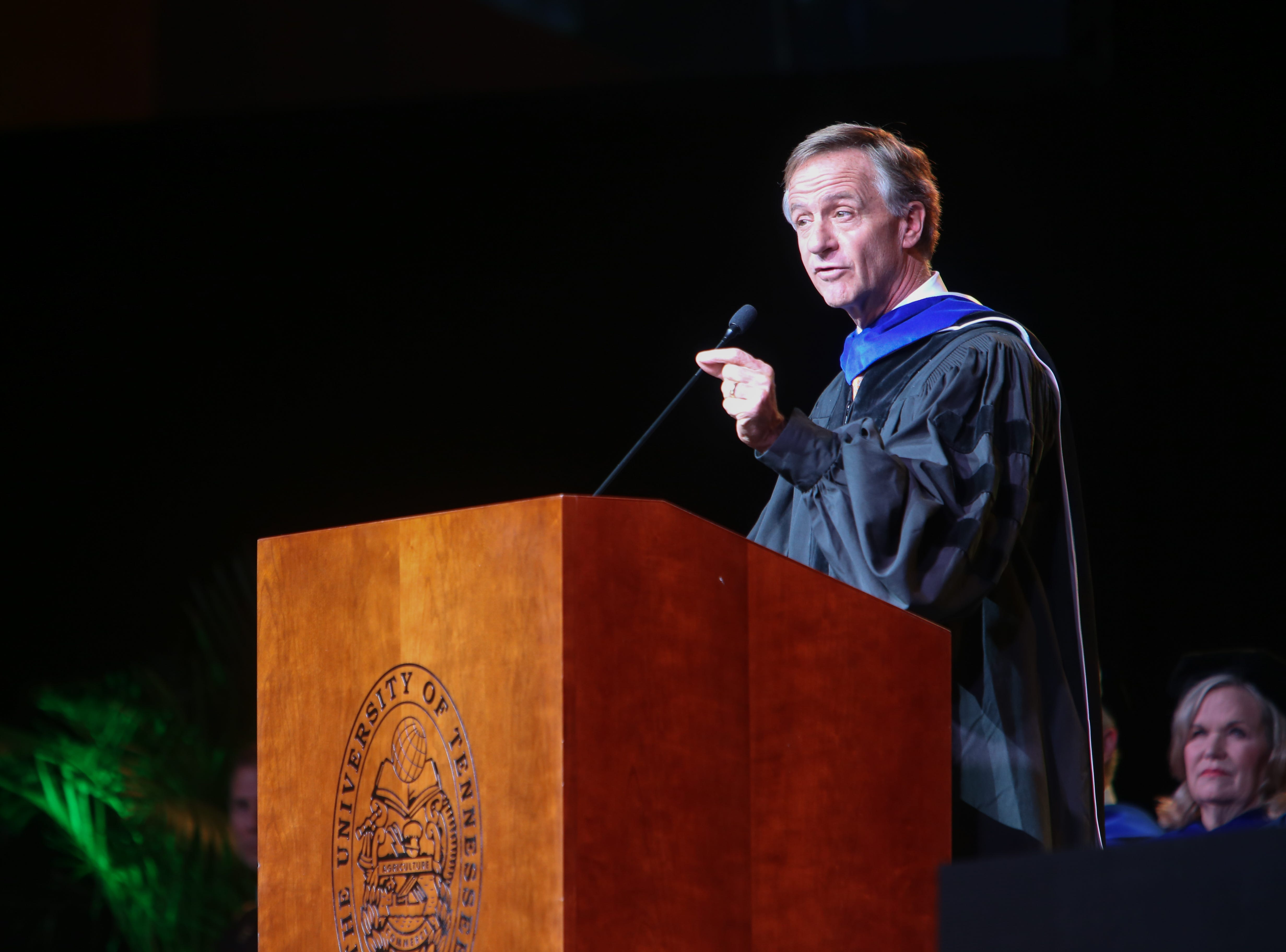 Gov. Bill Haslam speaks to the graduates during the University of Tennessee winter Commencement ceremony at Thompson-Boling Assembly Center and Arena in Knoxville Friday, Dec. 14, 2018.