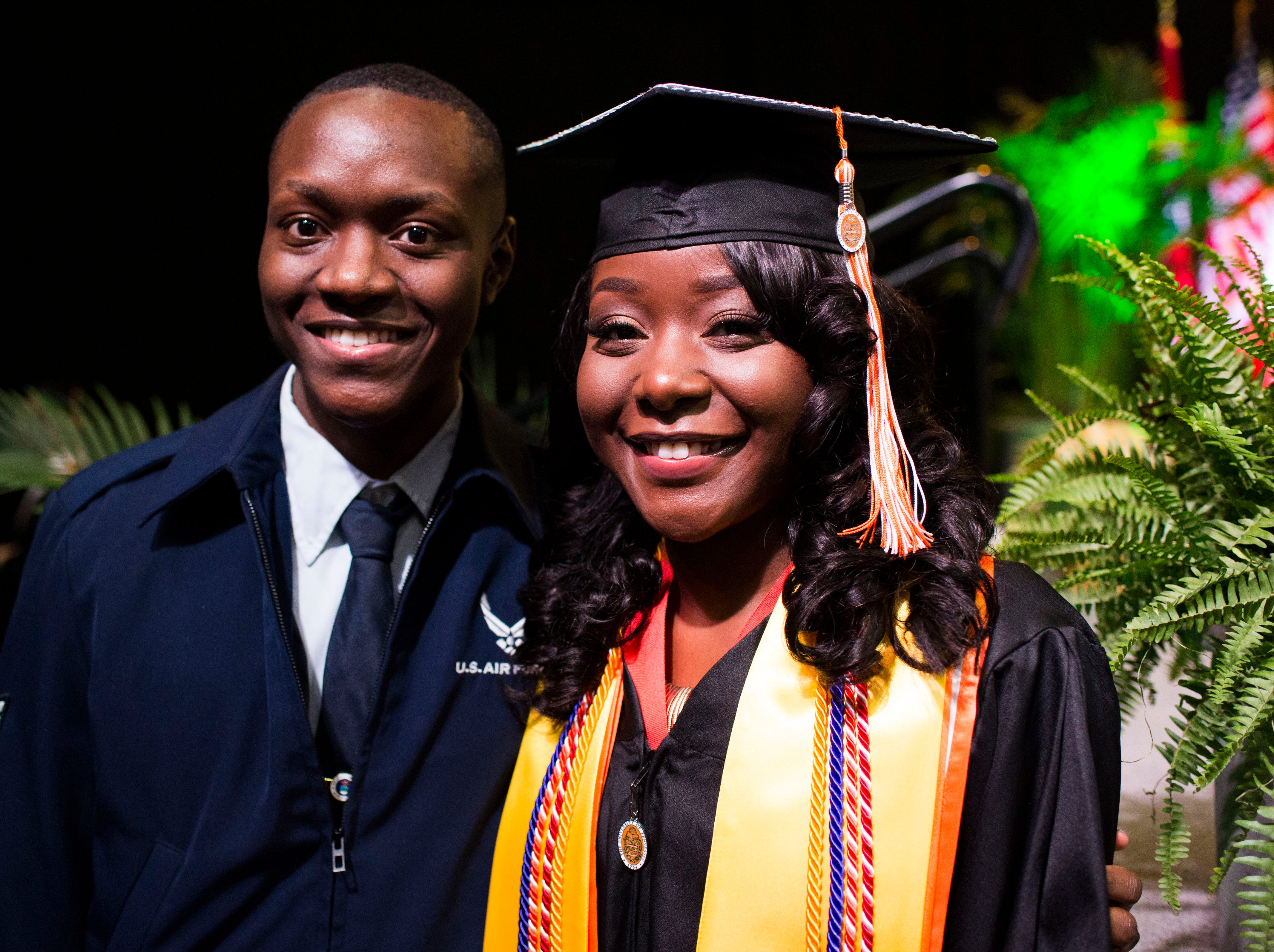 Airman Jerald Linsey Jr. poses for a photo with his sister Amaya Linsey after University of Tennessee's graduation in Thompson-Boling Arena Friday, Dec. 14, 2018. Jerald, who had not seen his sister for a year, surprised Amaya after she crossed the stage to receive her diploma.