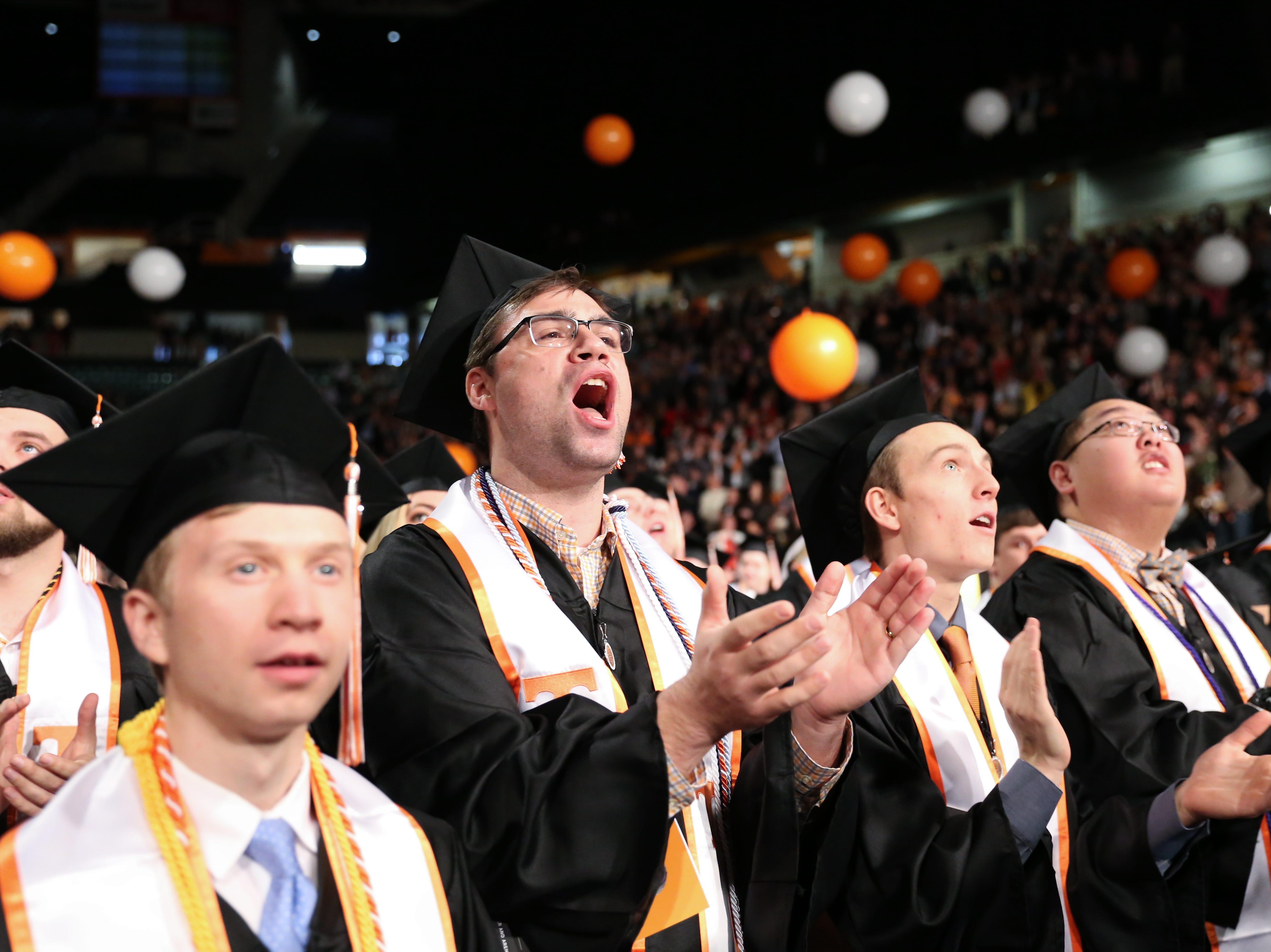 "Graduate Kyle Ingram sings ""Rocky Top"" with his classmates during the University of Tennessee winter Commencement ceremony at Thompson-Boling Assembly Center and Arena in Knoxville Friday, Dec. 14, 2018."