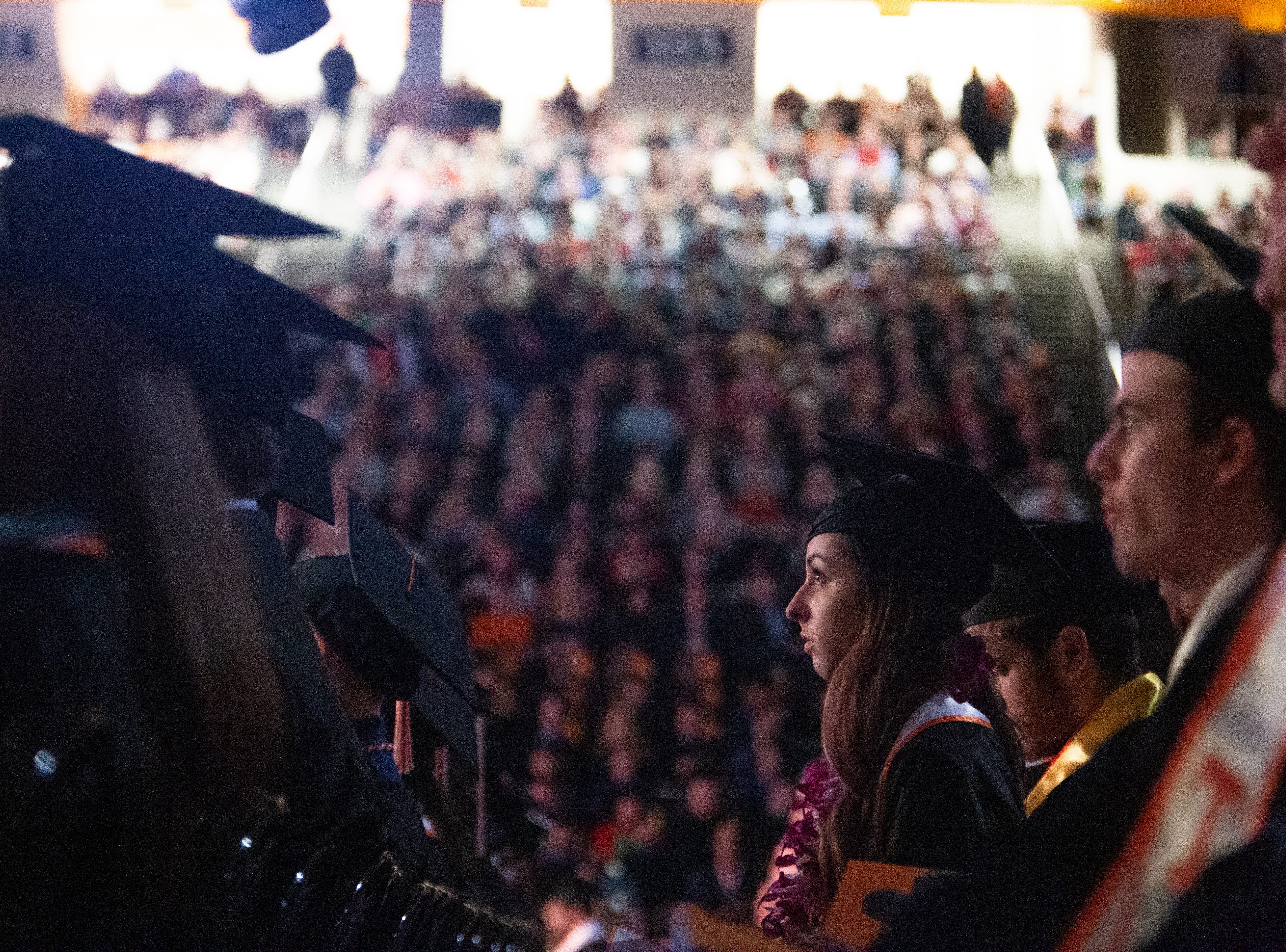 A graduate listens to the Chancellor Wayne T. Davis speak during the University of Tennessee winter Commencement ceremony at Thompson-Boling Assembly Center and Arena in Knoxville Friday, Dec. 14, 2018.