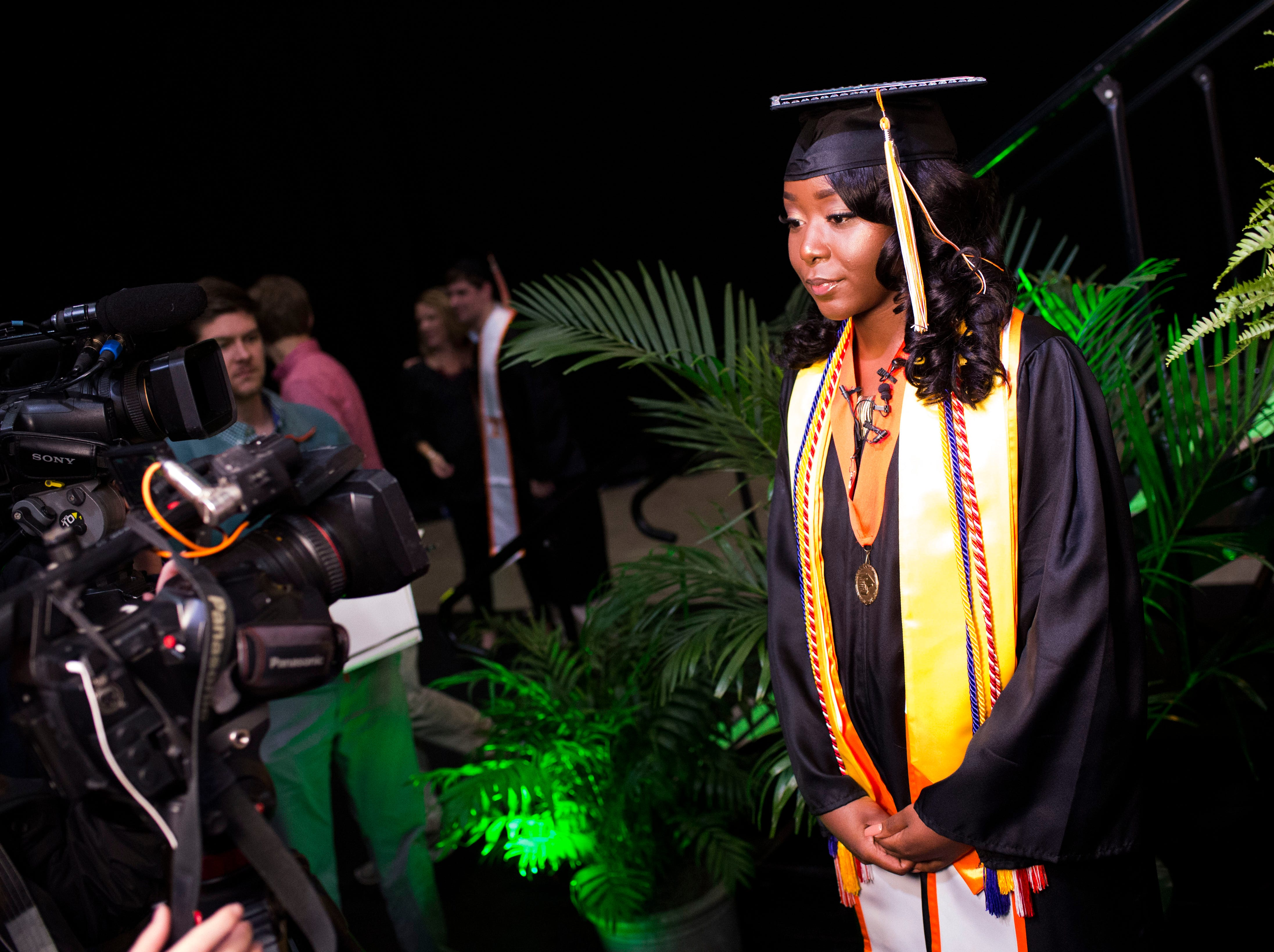 Amaya Linsey speaks to the media after University of Tennessee's graduation in Thompson-Boling Arena Friday, Dec. 14, 2018. Her brother, Airman Jerald Linsey Jr., whom she had not seen in a year, surprised her after she crossed the stage to receive her diploma.
