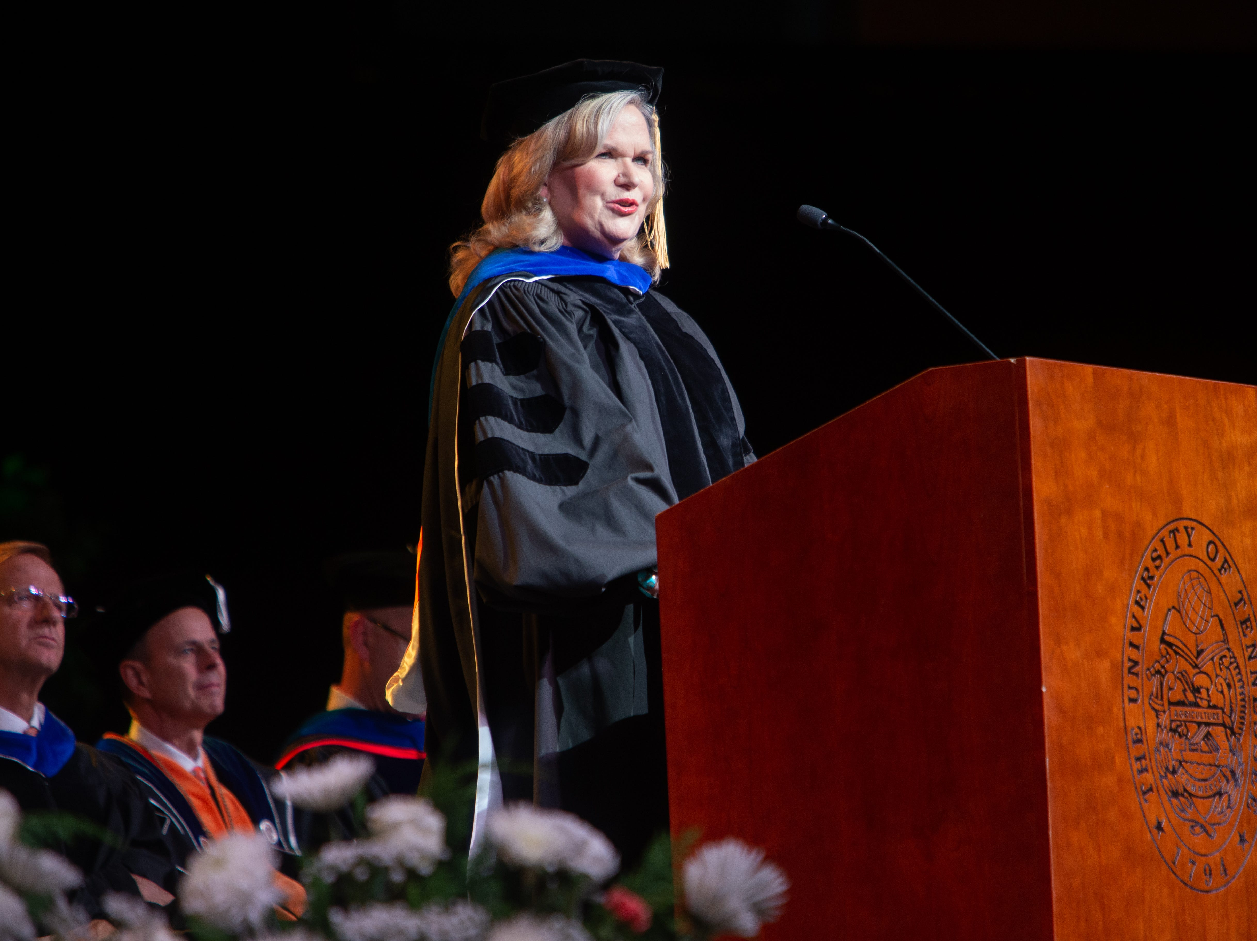Alumni Susan Crunk speaks to the graduates during the University of Tennessee winter Commencement ceremony at Thompson-Boling Assembly Center and Arena in Knoxville Friday, Dec. 14, 2018.