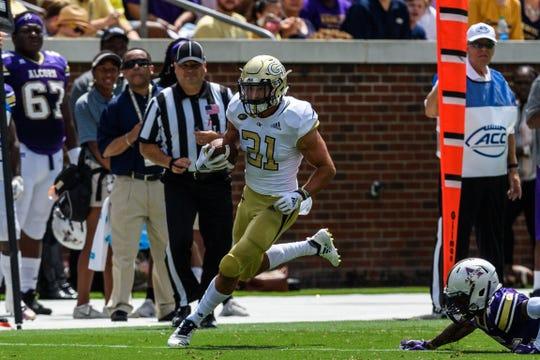 Nathan Cottrell runs the ball for Georgia Tech.