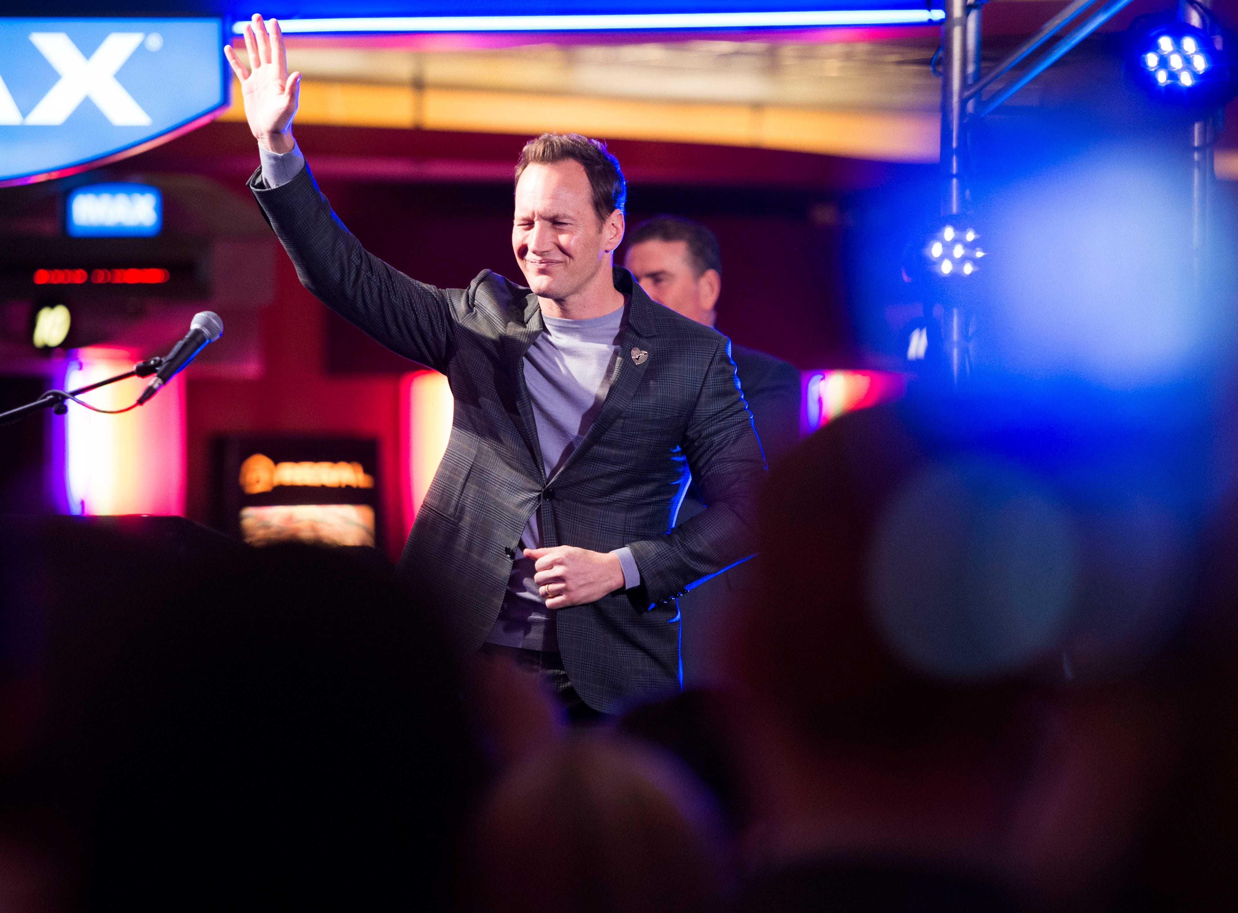 """""""Aquaman"""" star Patrick Wilson waves to attendees as he leaves the stage at Regal's annual red carpet premiere for Variety at Regal Pinnacle Stadium 18, Thursday, Dec. 13, 2018."""