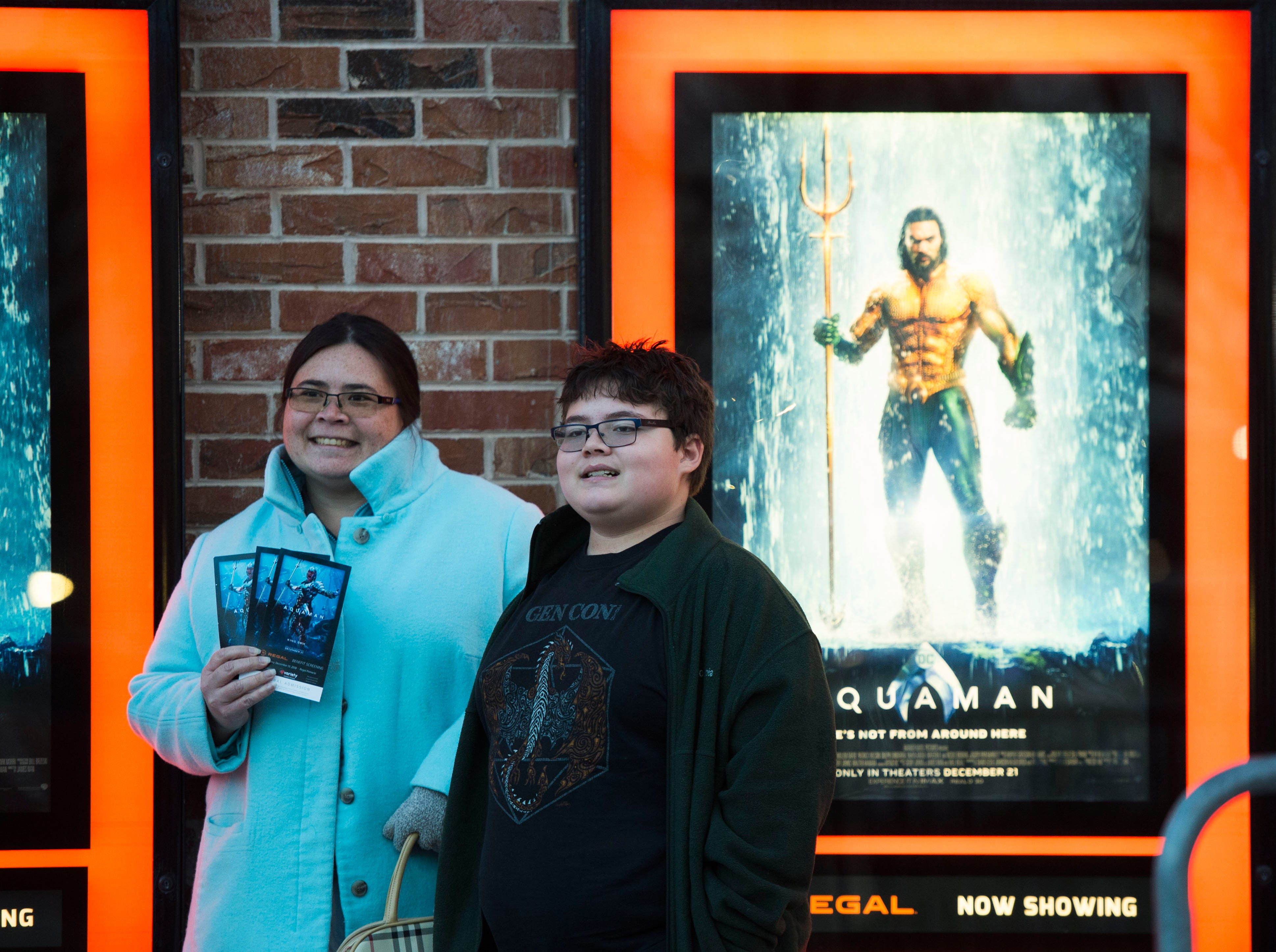 """Airika White and her son Richard, 12, pose for a photo while waiting for """"Aquaman"""" star Patrick Wilson to arrive at Regal's annual red carpet premiere for Variety at Regal Pinnacle Stadium 18, Thursday, Dec. 13, 2018."""