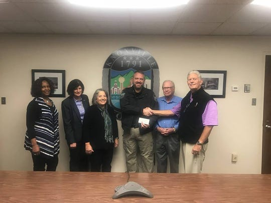 The Knoxville Public Safety Foundation presented Knoxville Police Department Officer B.K. Hardin with a check to support expenses related to an on-duty injury, Thursday, December 13, 2018. Hardin was attacked November 17 while directing traffic for a University of Tennessee football game.