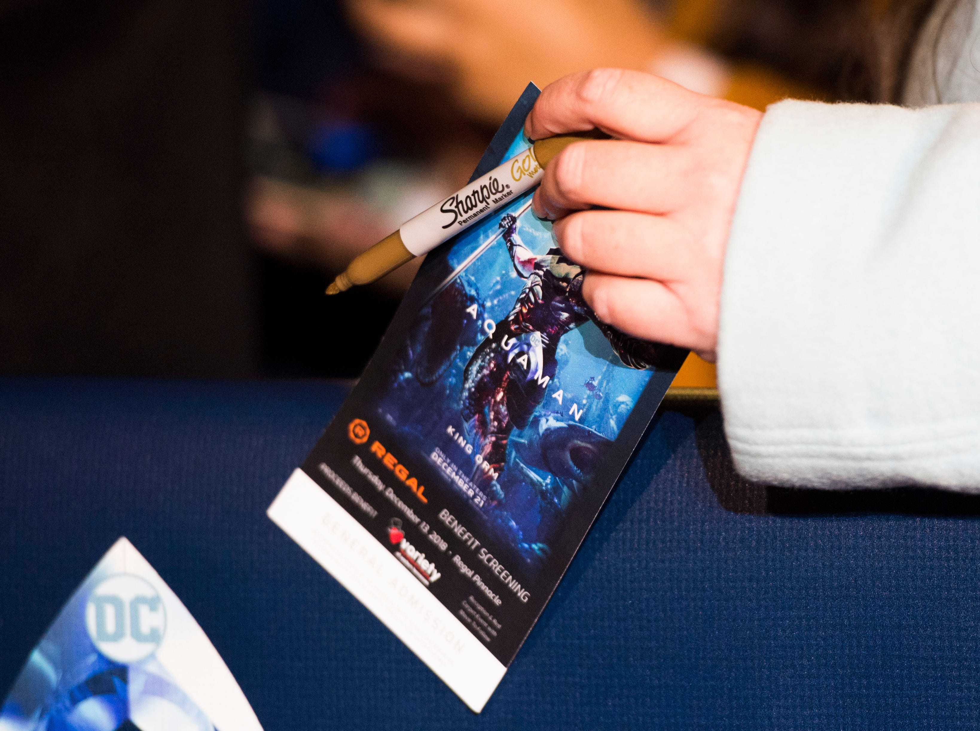 """A fan stands ready for an autograph from """"Aquaman"""" star Patrick Wilson at Regal's annual red carpet premiere for Variety at Regal Pinnacle Stadium 18, Thursday, Dec. 13, 2018."""