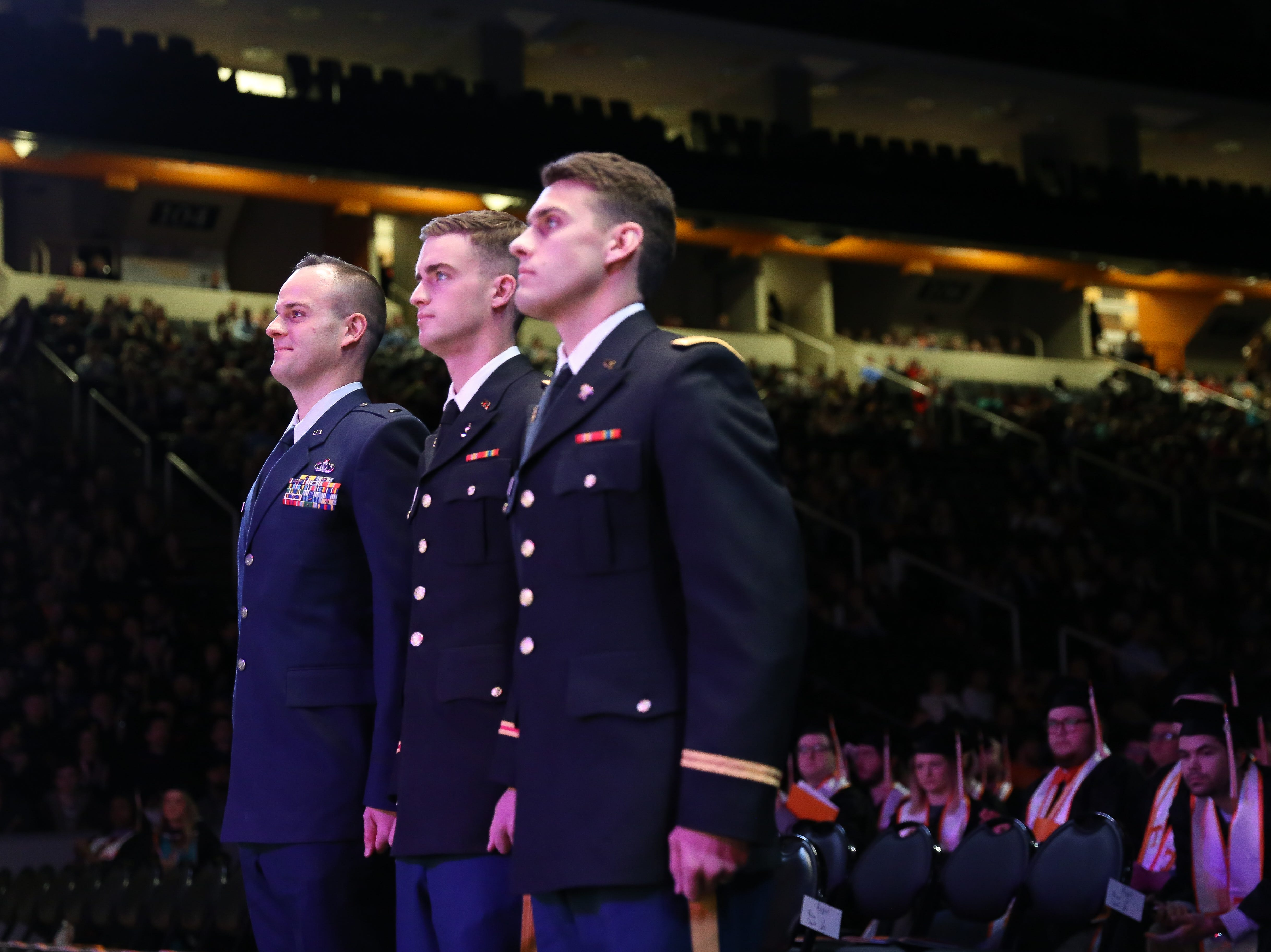 Commissions in the United States Armed Forces are honored during the University of Tennessee winter Commencement ceremony at Thompson-Boling Assembly Center and Arena in Knoxville Friday, Dec. 14 2018.