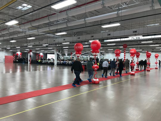 Guests file through the huge new DENSO plant in Maryville for its grand opening Dec. 14, 2018.