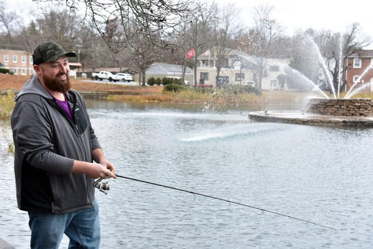 Matthew Dunn traveled from Strawberry Plains to Fountain City to fish as the Tennessee Wildlife Resources Agency stocked the lake with rainbow trout on Friday, Dec. 14, 2018.
