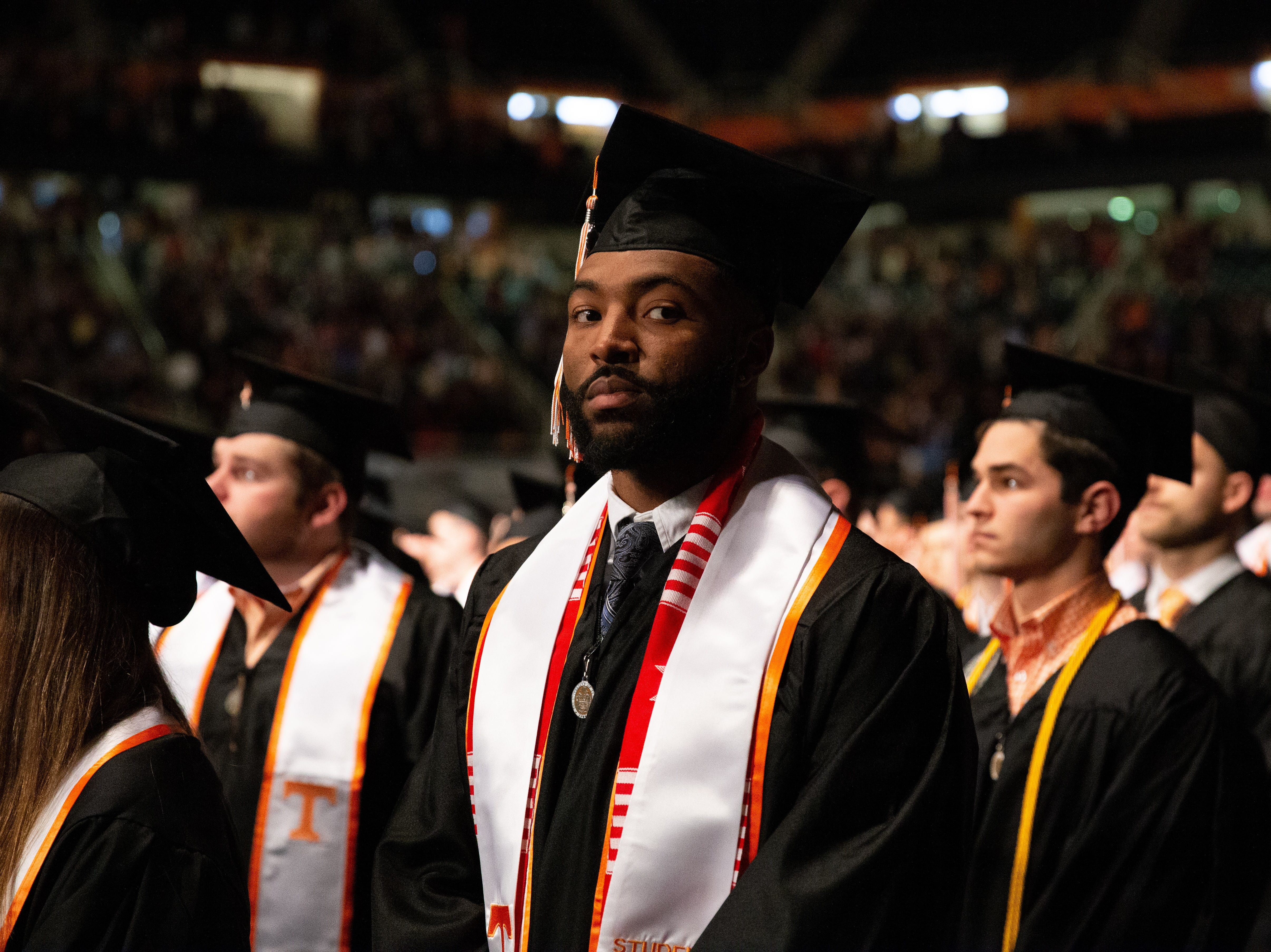 Graduate Micah Abernathy waits his turn to be called to the stage during the University of Tennessee winter Commencement ceremony atThompson-Boling Assembly Center and Arena in Knoxville Friday, Dec. 14, 2018.
