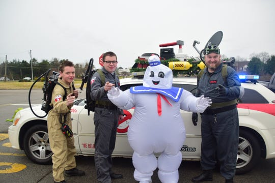 The Ghost Busters were one hand with Ecto-1 and the Stay Puft Marshmallow man at the Karns Community Christmas Parade Saturday, Dec. 8. Pictured from left is Jordan Amburn, Jacob Amburn, Stay Puft Marshmallow, and Cole Amburn.
