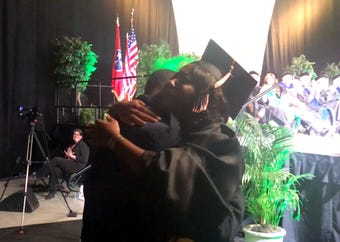 UT graduate Amaya Linsey had a surprise waiting for her at the bottom of the ramp on graduation day: Her brother, Airman First Class Jerald Linsey Jr.