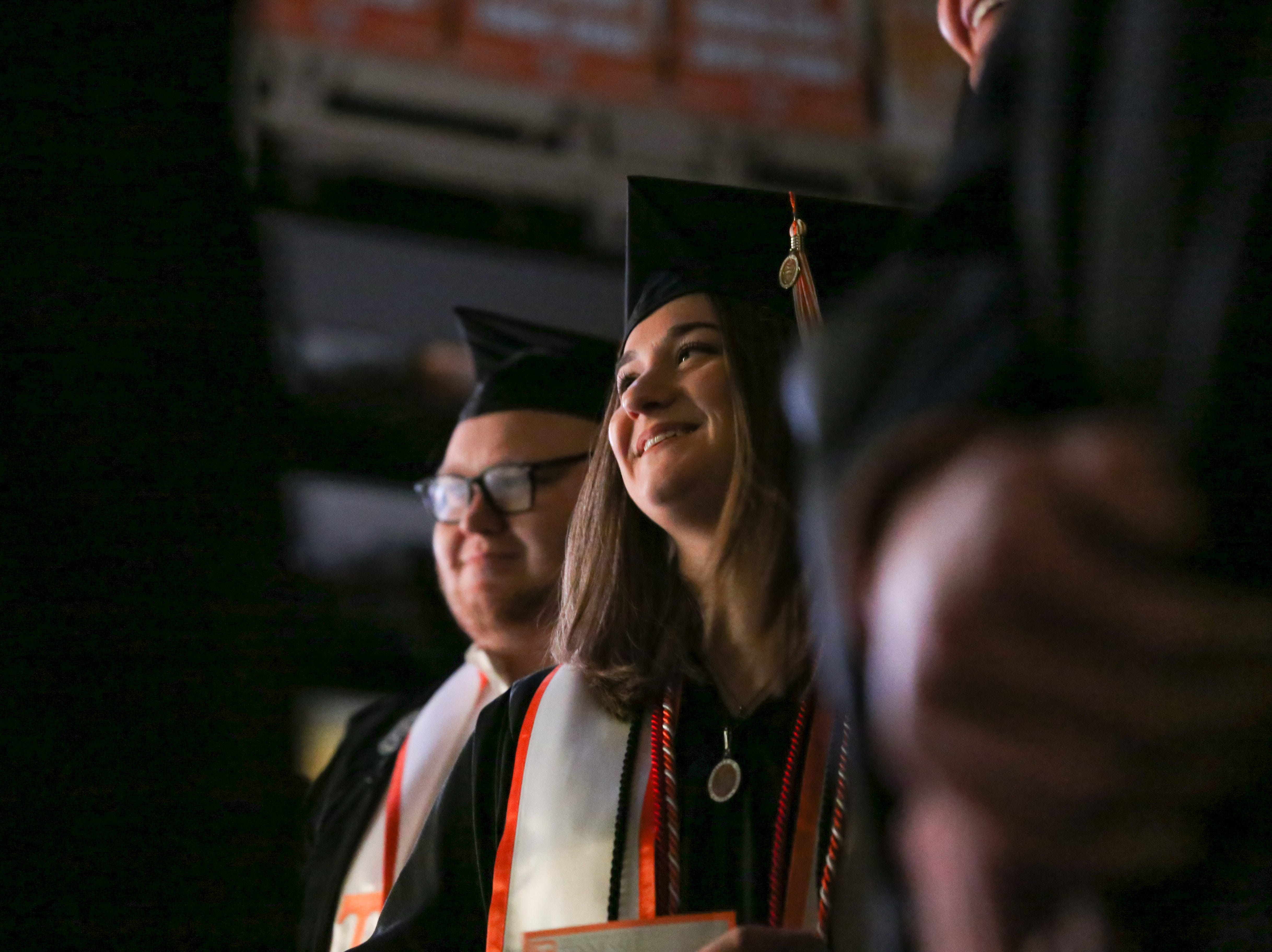 Graduates smile before they are called to the stage during the University of Tennessee winter Commencement ceremony at Thompson-Boling Assembly Center and Arena in Knoxville Friday, Dec. 14, 2018.