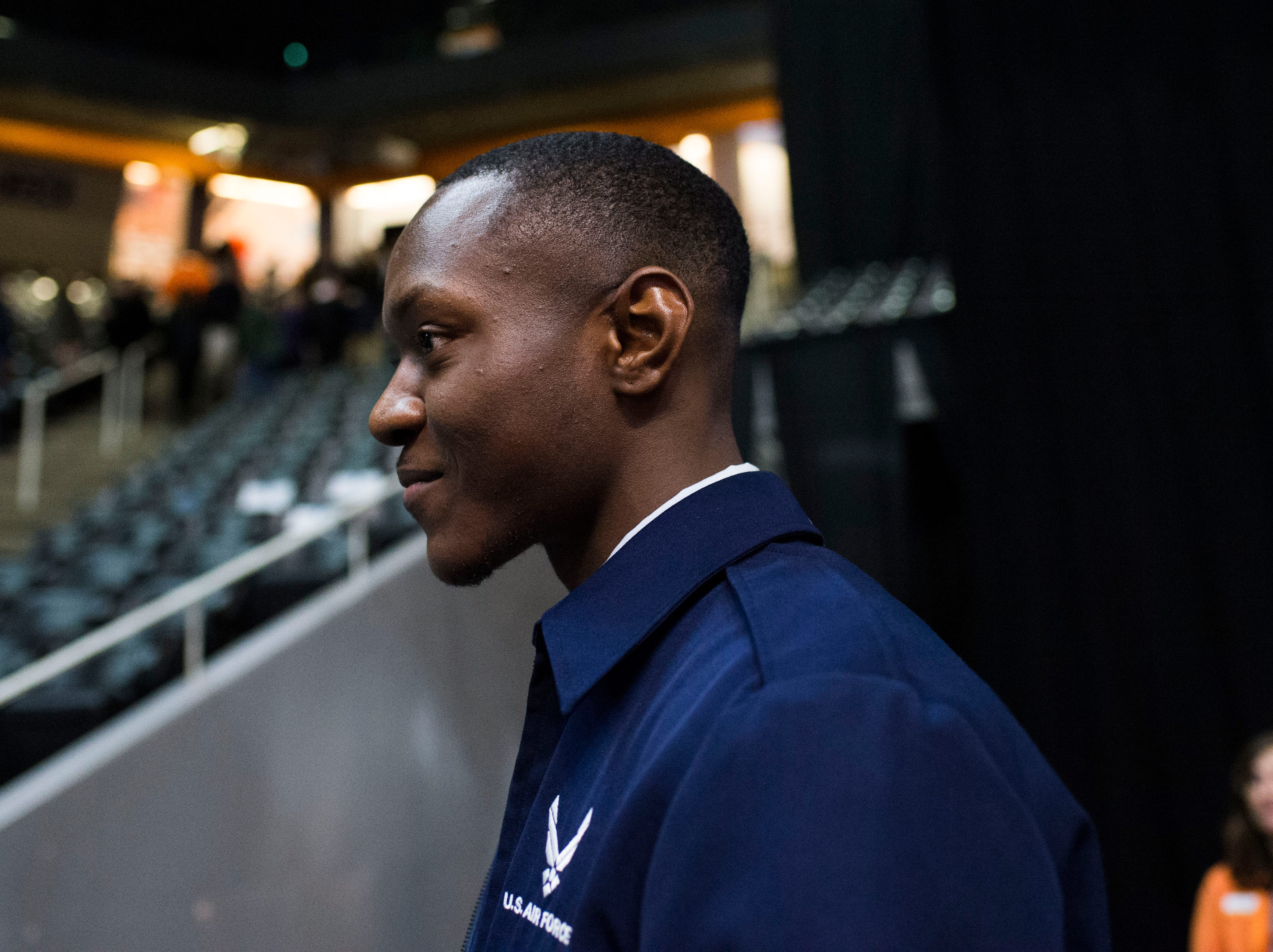Airman Jerald Linsey Jr. stands in Thompson-Boling arena after surprising his sister Amaya Linsey when she received her diploma Friday, Dec. 14, 2018. The two had not seen each other in a year.