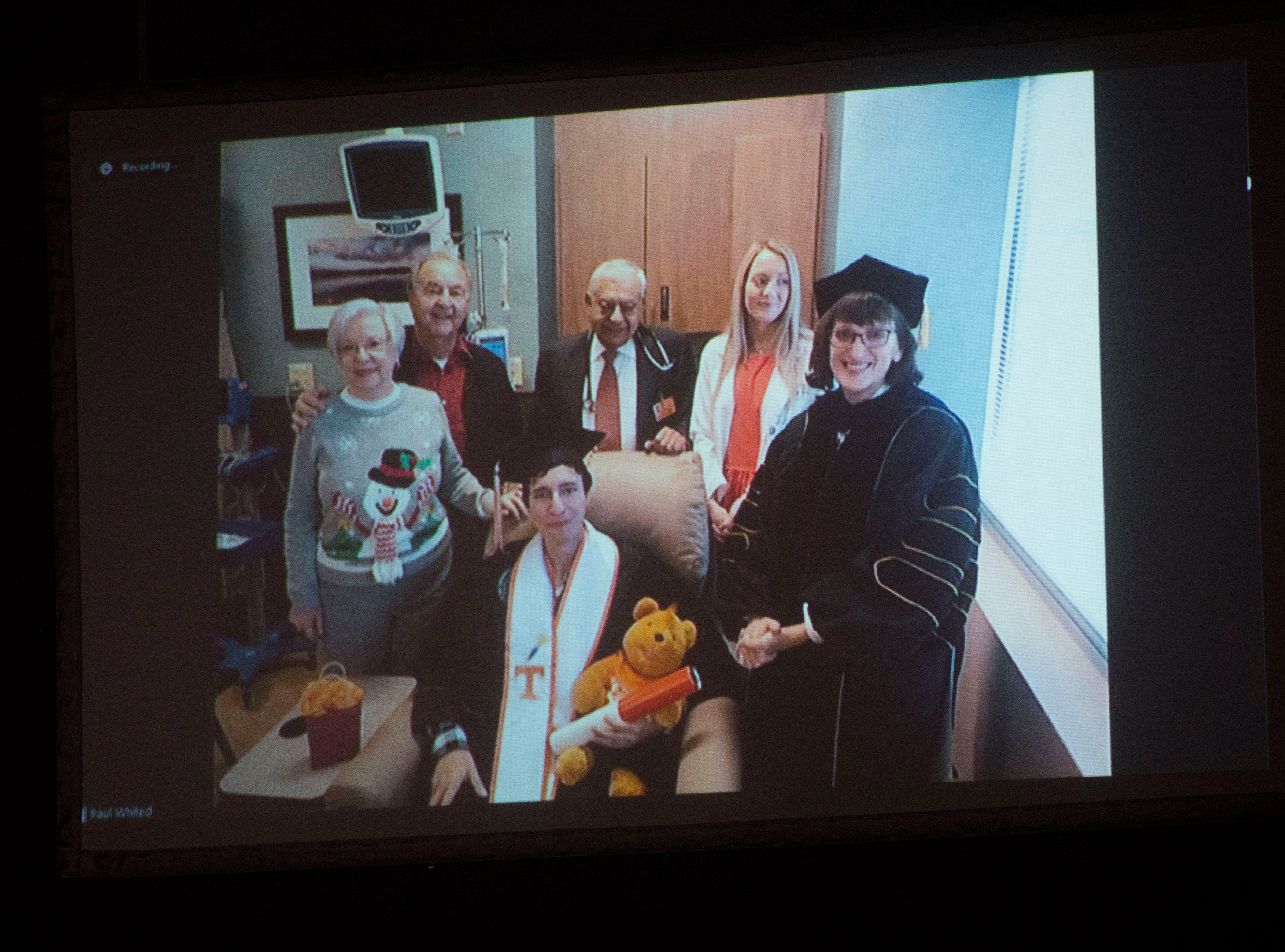 A video is shown of student Paul Whited (at center), surrounded by family during University of Tennessee's graduation Friday, Dec. 14, 2018. Whited is currently undergoing chemotherapy at University of Tennessee Medical Center.