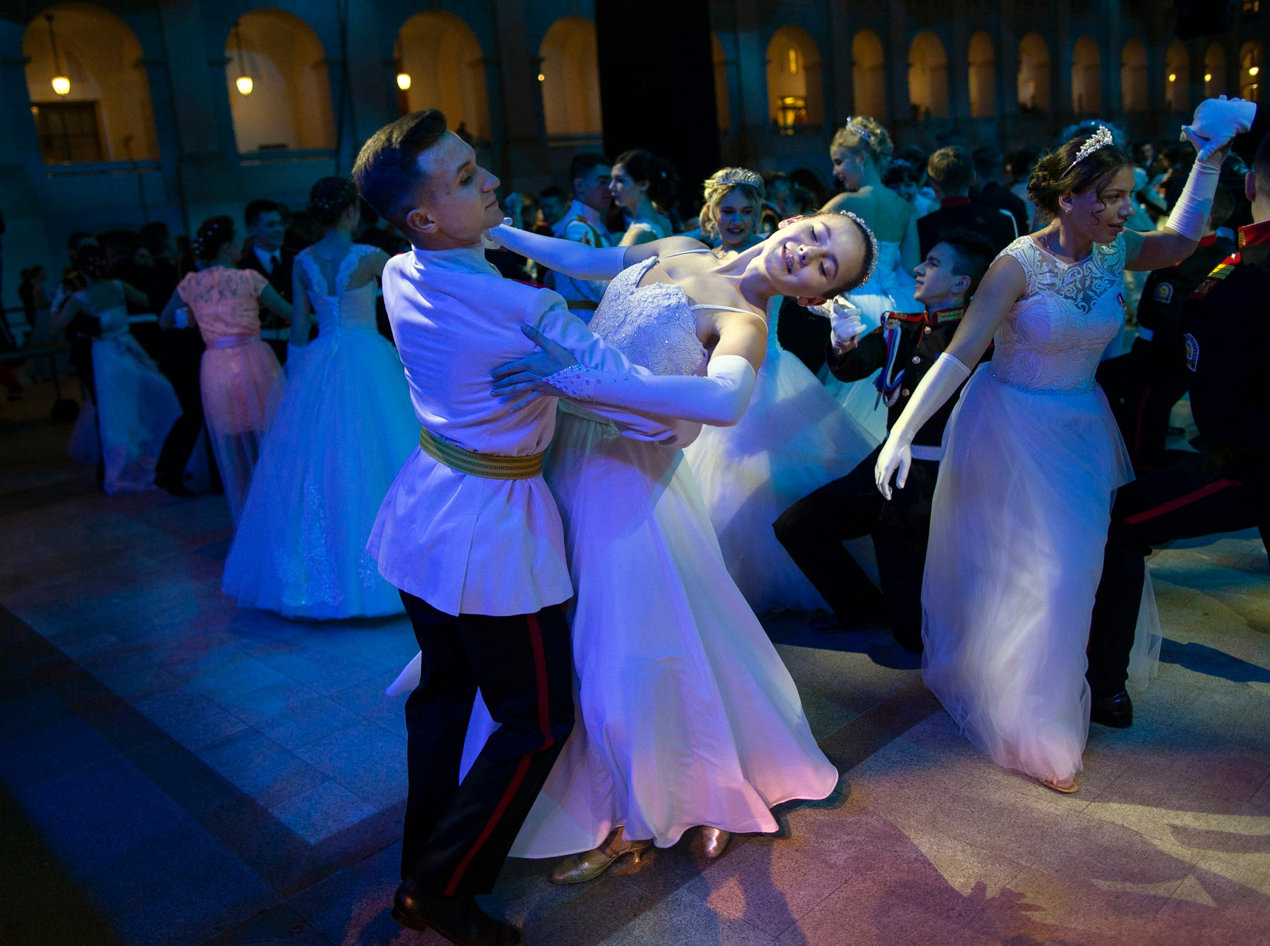 Participants of a ball for students of military schools dance during an annual ball in Moscow, Russia, Tuesday, Dec. 11, 2018. In the revival of a czarist tradition, more than 1,000 students both from military and general schools travelled from all over Russia to Moscow to take part in the annual ball. (AP Photo/Alexander Zemlianichenko)
