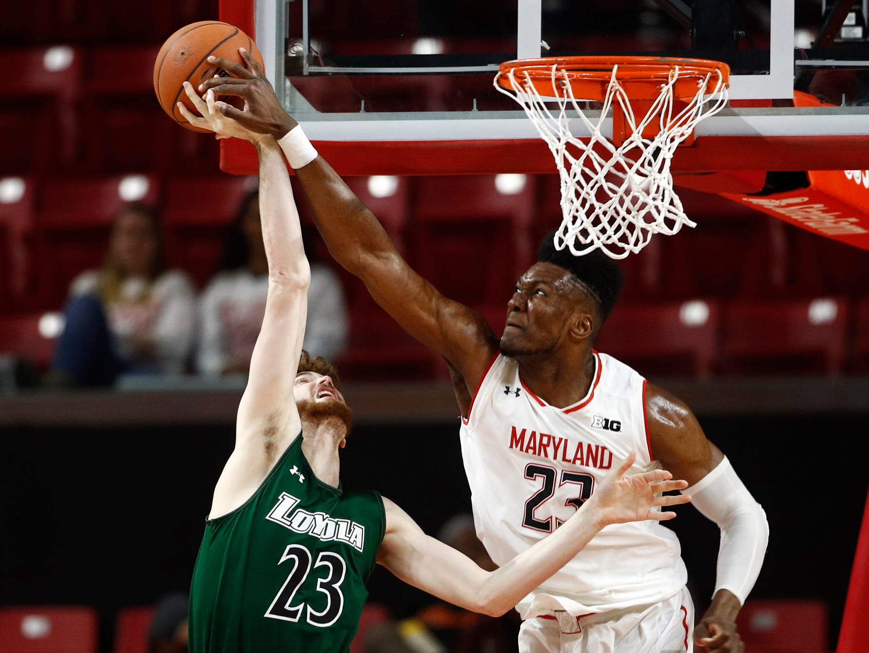 Maryland forward Bruno Fernando, right, of Angola, blocks a shot attempt by Loyola-Maryland forward Brent Holcombe in the second half of an NCAA college basketball game, Tuesday, Dec. 11, 2018, in College Park, Md. Maryland won 94-71. (AP Photo/Patrick Semansky)
